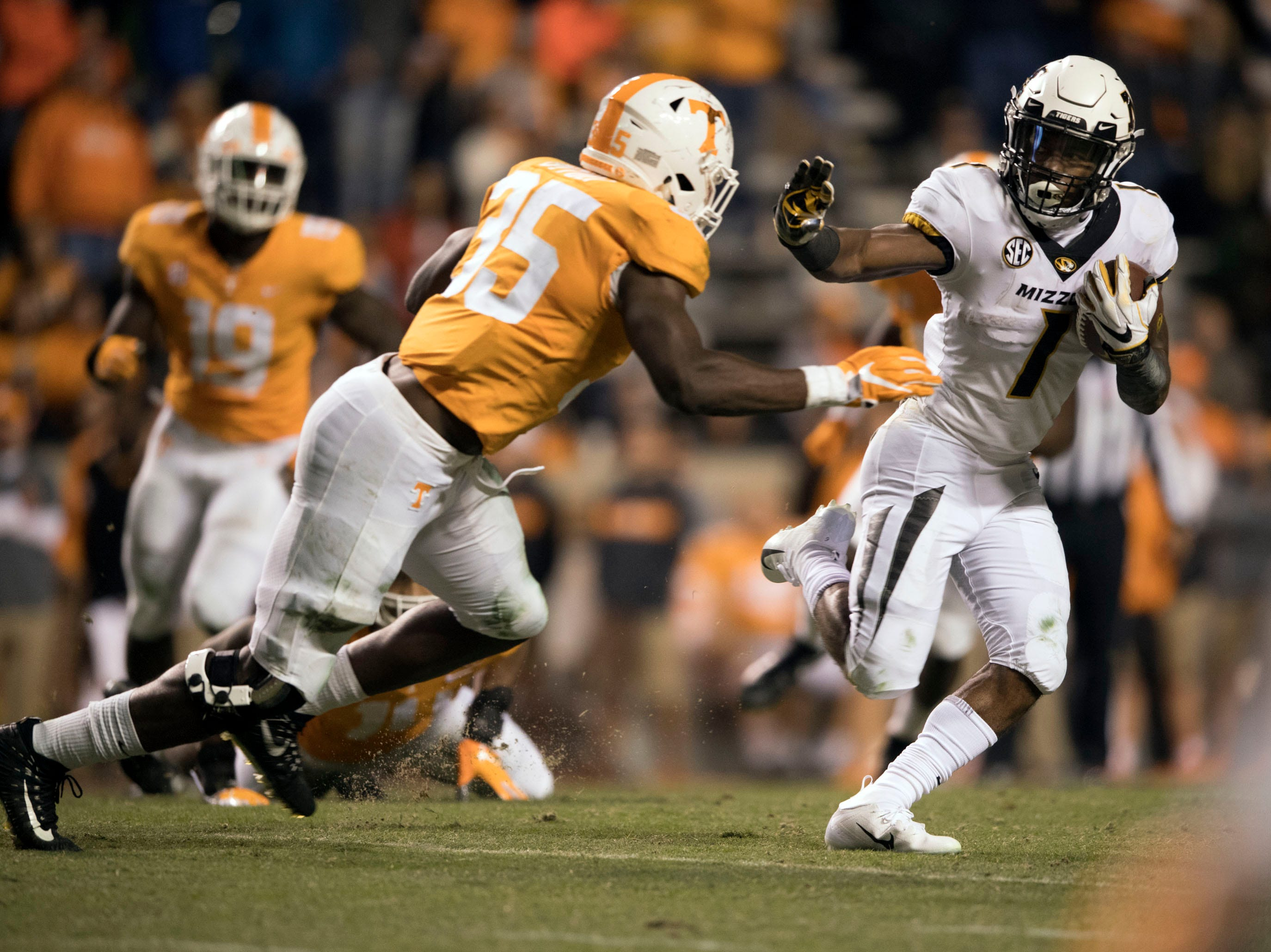 Missouri running back Tyler Badie (1) is pursued by Tennessee linebacker Daniel Bituli (35) during the Tennessee and Missouri football game on Saturday, November 17, 2018.
