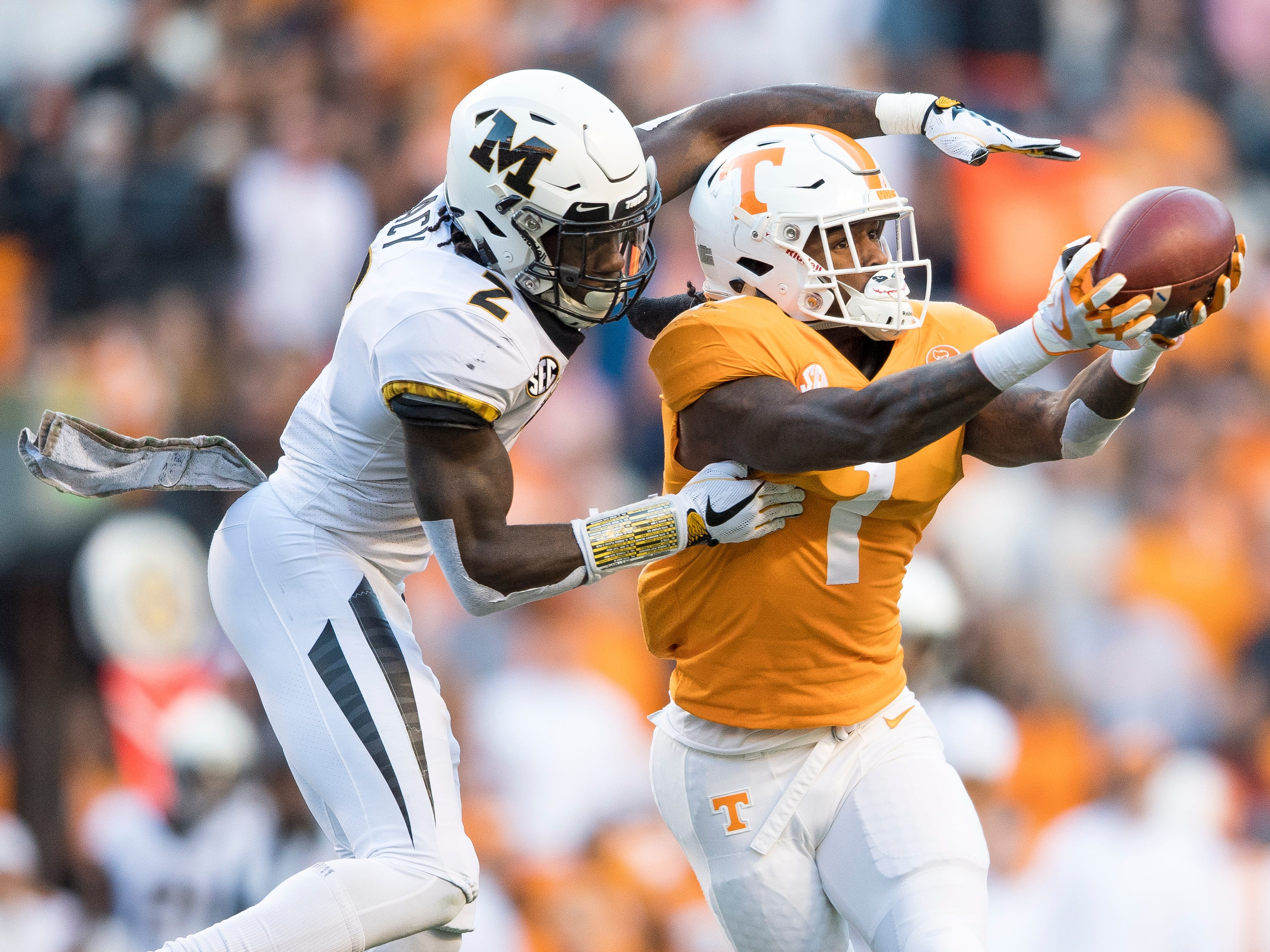 Tennessee wide receiver Marquez Callaway (1) makes a catch while defended by Missouri defensive back DeMarkus Acy (2) during the Tennessee Volunteers game against the Missouri Tigers in Neyland Stadium on Saturday, November 17, 2018.