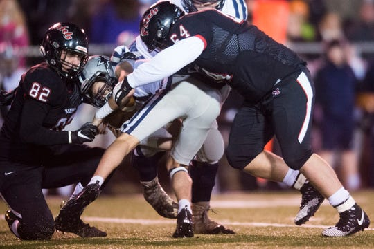 Farragut's Gavin Wilkinson (11) is sacked by Maryville players during a 6A quarterfinal game between Maryville and Farragut at Maryville Friday, Nov. 16, 2018. Maryville defeated Farragut 26-10.