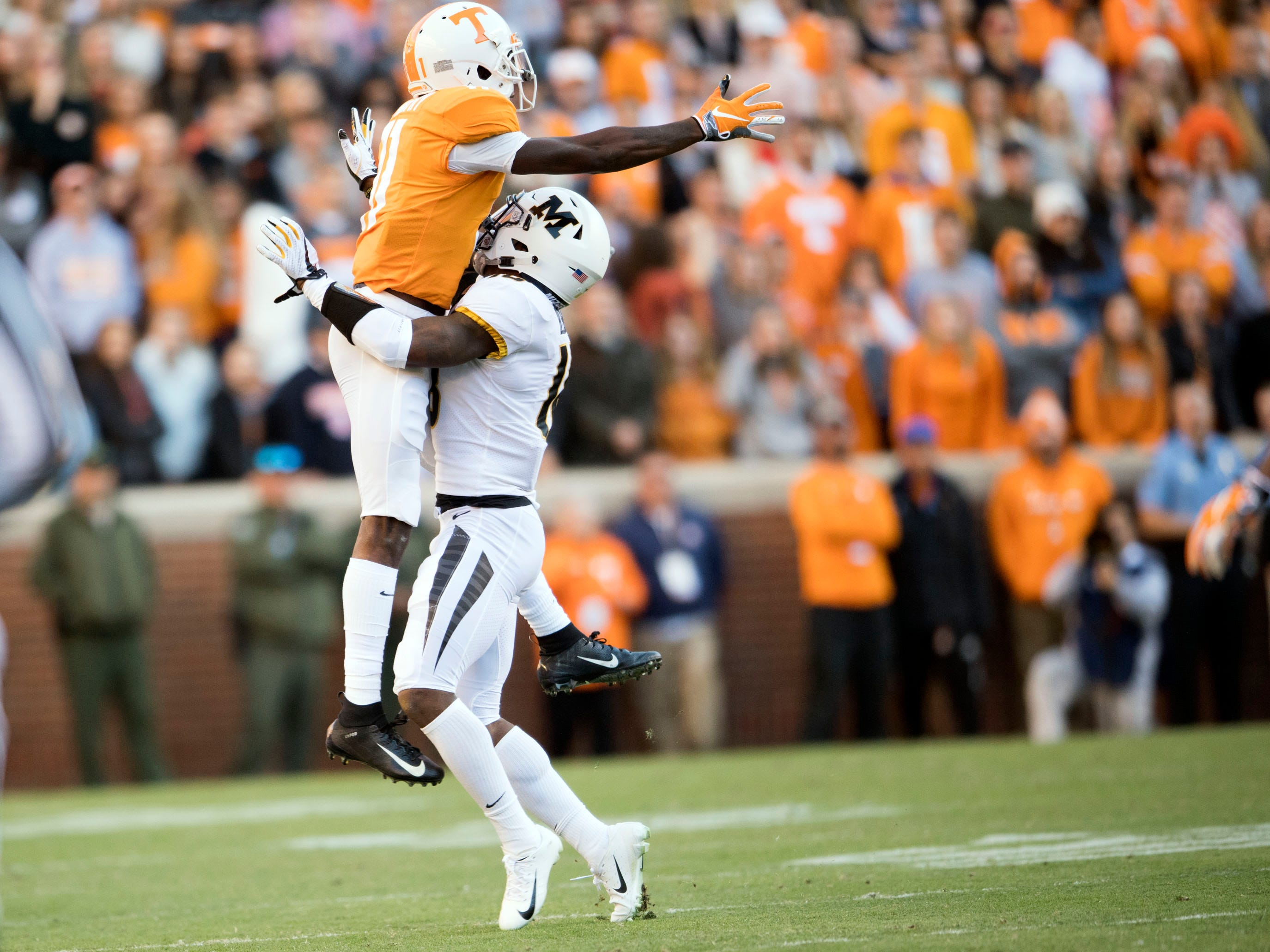 Tennessee wide receiver Jordan Murphy (11) is defended by Missouri safety Joshuah Bledsoe (18) during a pass attempt in the Tennessee and Missouri football game on Saturday, November 17, 2018.