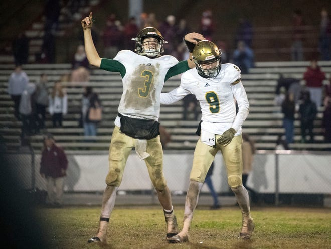 Knoxville Catholic's Jack Jancek (3) and Adam Jones (9) celebrate their 42-40 win over Oak Ridge in the 5A quarterfinals on Friday, November 16, 2018.