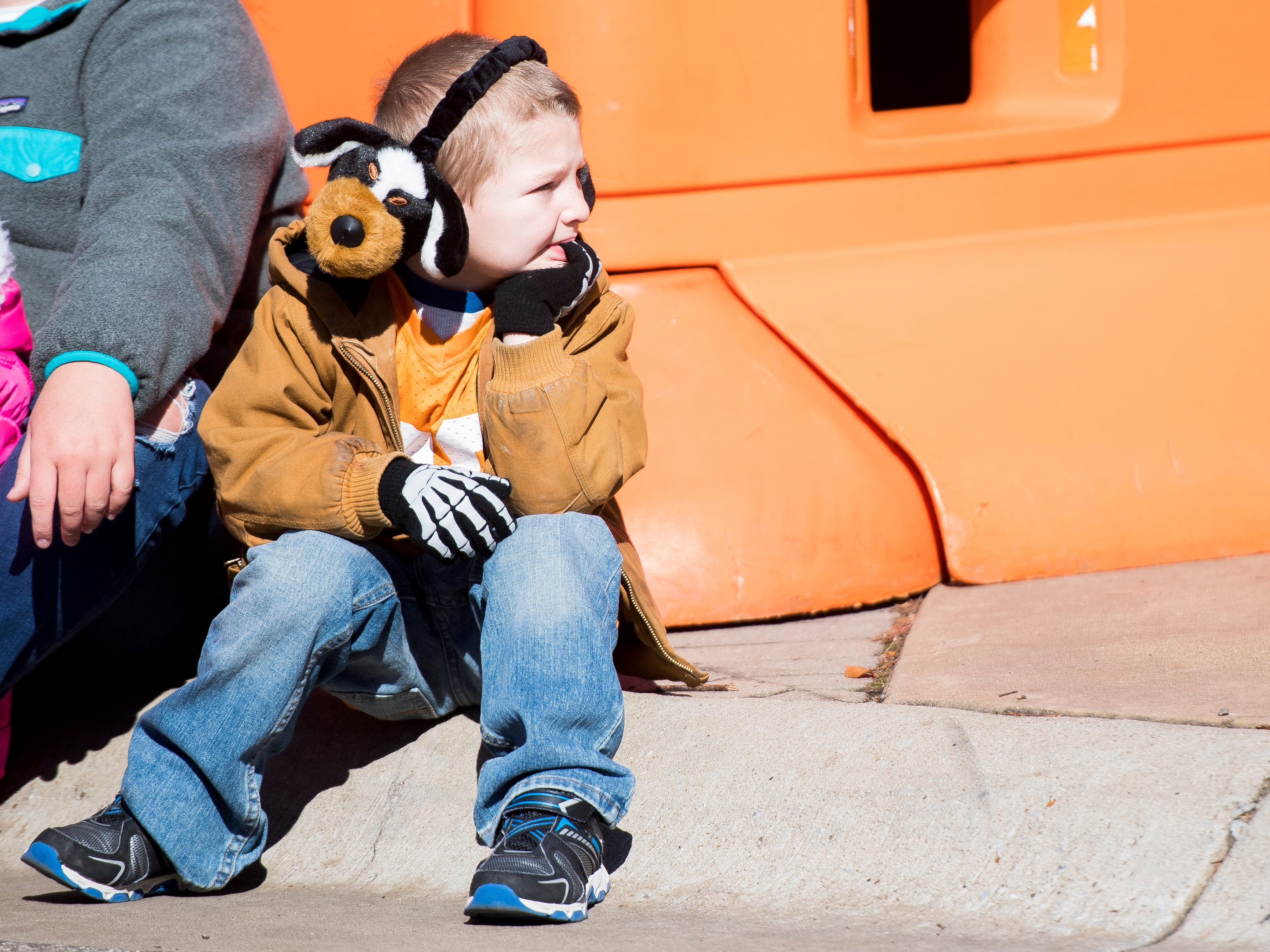 A child wear Smokey ear muffs before the Tennessee Volunteers take on the Missouri Tigers in Neyland Stadium on Saturday, November 17, 2018.