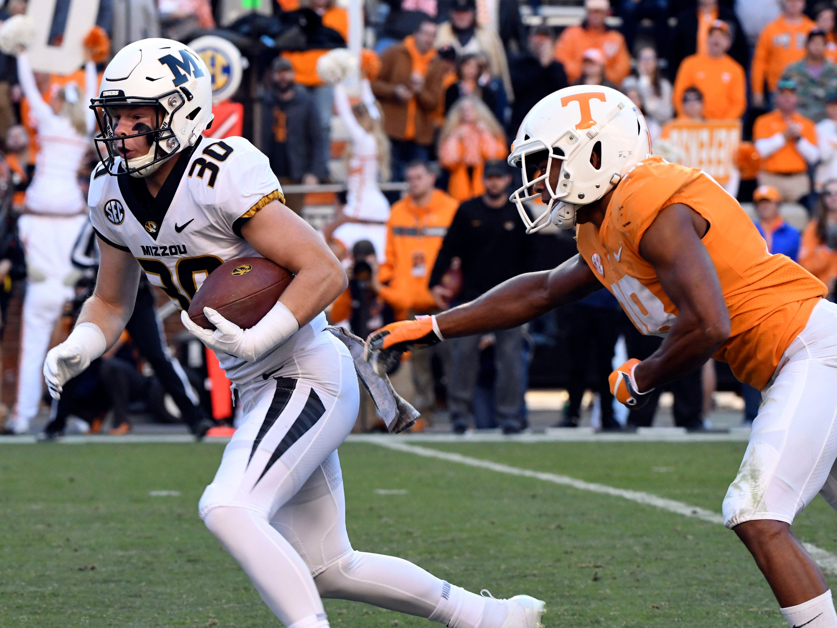 Missouri wide receiver Barrett Banister (30) is pursued by Tennessee defensive back Nigel Warrior (18) during the Tennessee and Missouri football game on Saturday, November 17, 2018.