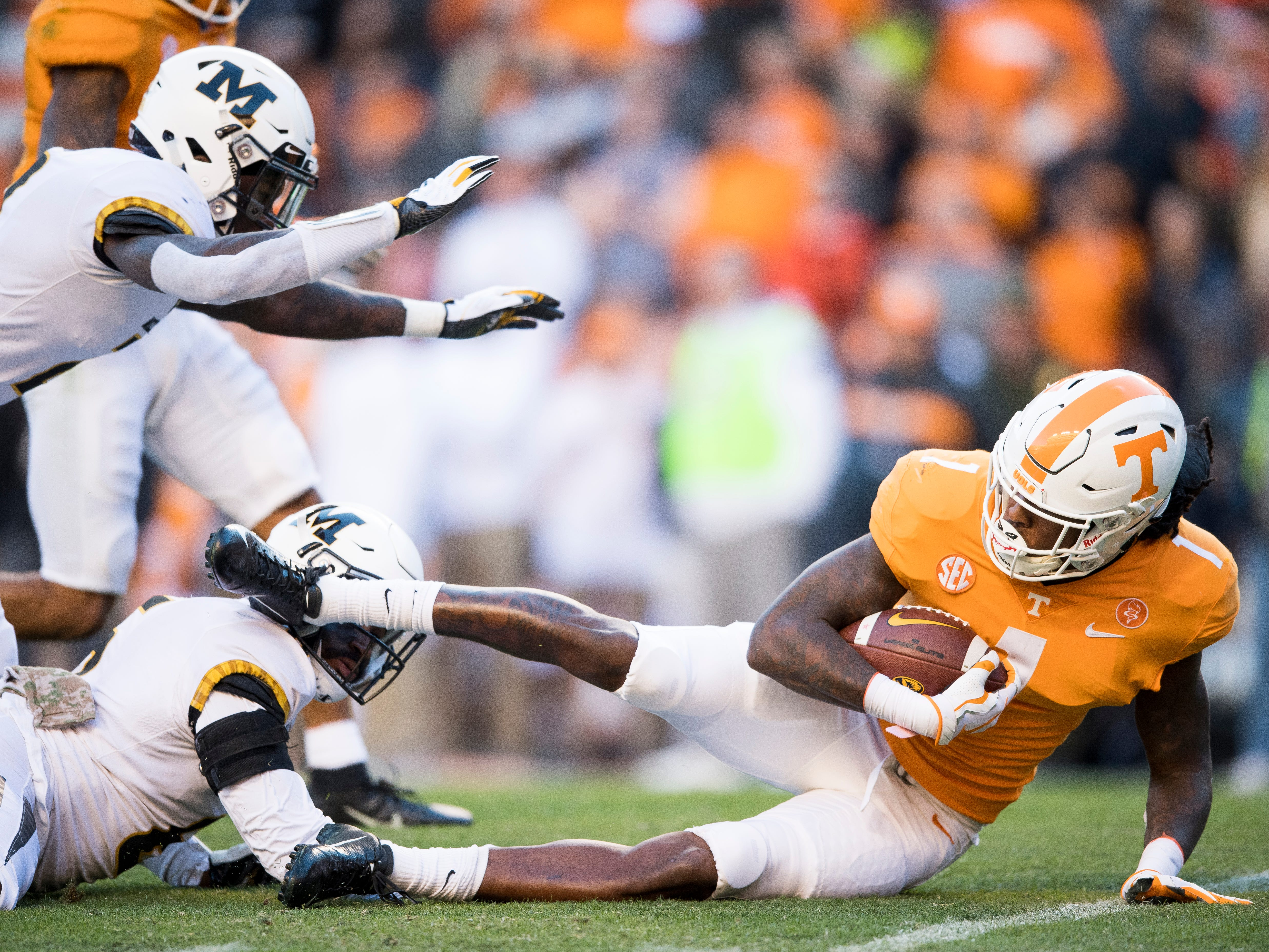 Tennessee wide receiver Marquez Callaway (1) is taken down during a punt return during the Tennessee Volunteers game against the Missouri Tigers in Neyland Stadium on Saturday, November 17, 2018. Missouri linebacker Tavon Ross (6) was rejected for targeting on Callaway.
