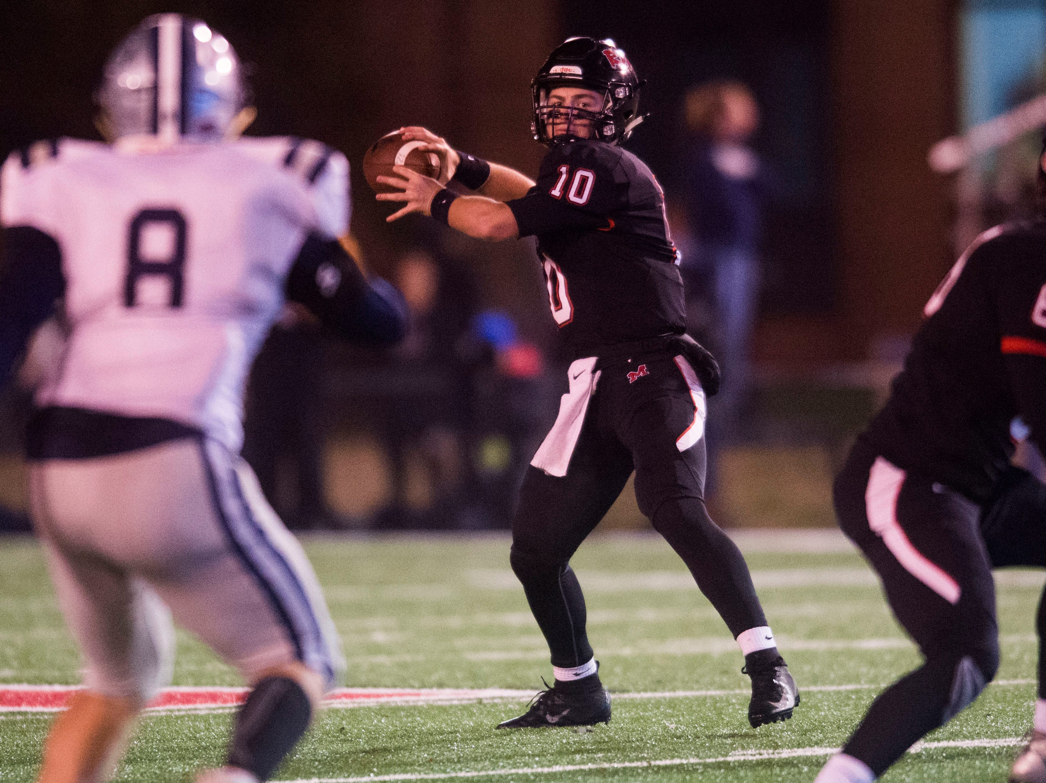 Maryville's Braden Carnes (10) throws the ball during a 6A quarterfinal game between Maryville and Farragut at Maryville Friday, Nov. 16, 2018. Maryville defeated Farragut 26-10.