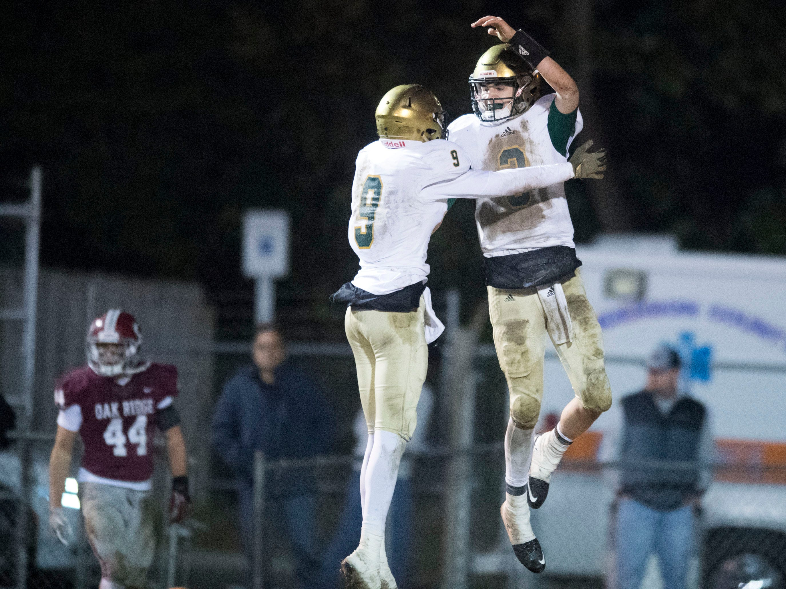 Knoxville Catholic's Adam Jones (9) and Jack Jancek (3) celebrate after Jancek scored a touchdown. Knoxville Catholic defeats Oak Ridge, 42-40 in the 5A quarterfinals on Friday, November 16, 2018.