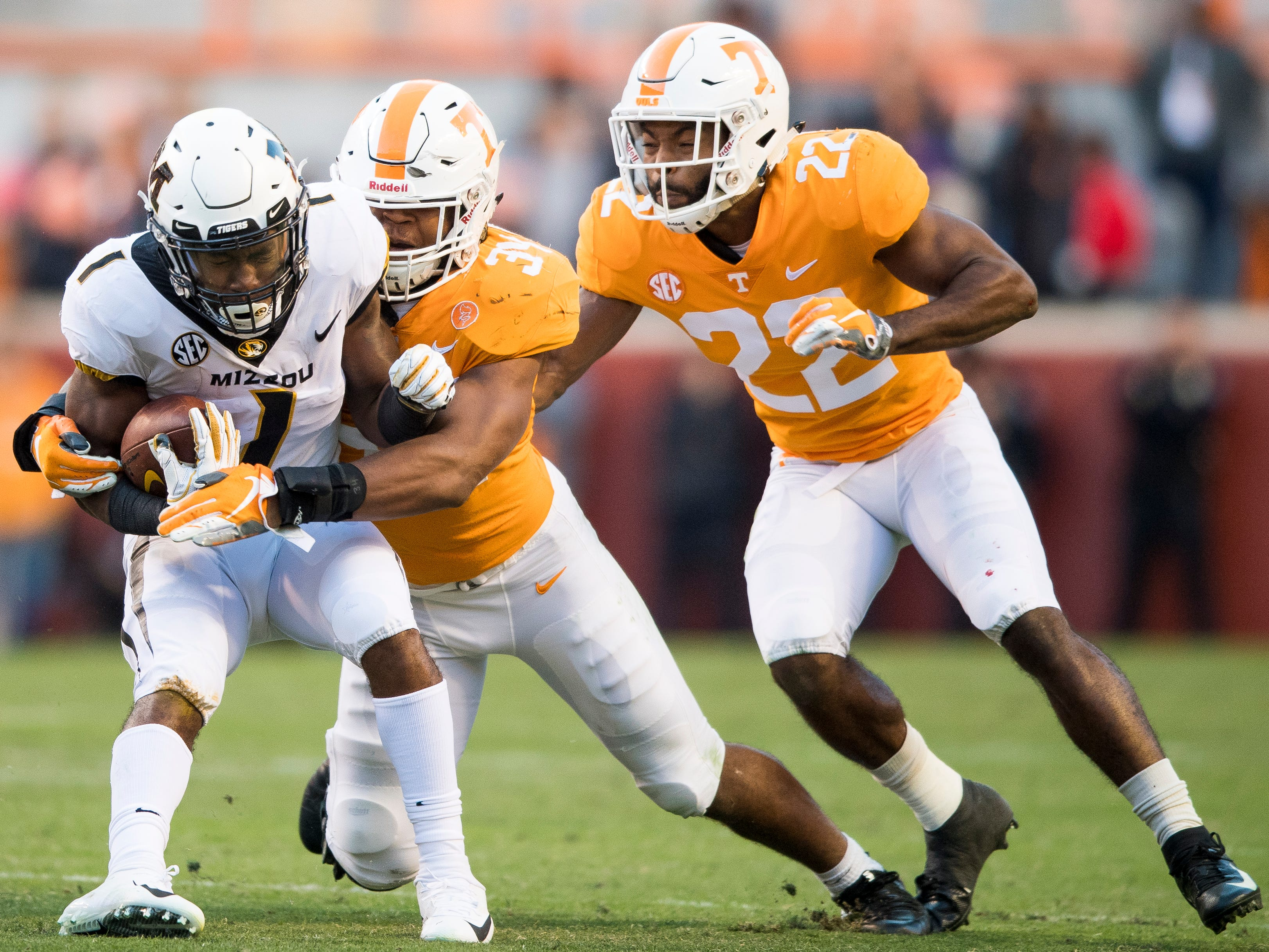 Tennessee linebacker Darrin Kirkland Jr. (34) takes down Missouri running back Tyler Badie (1) during the Tennessee Volunteers game against the Missouri Tigers in Neyland Stadium on Saturday, November 17, 2018.