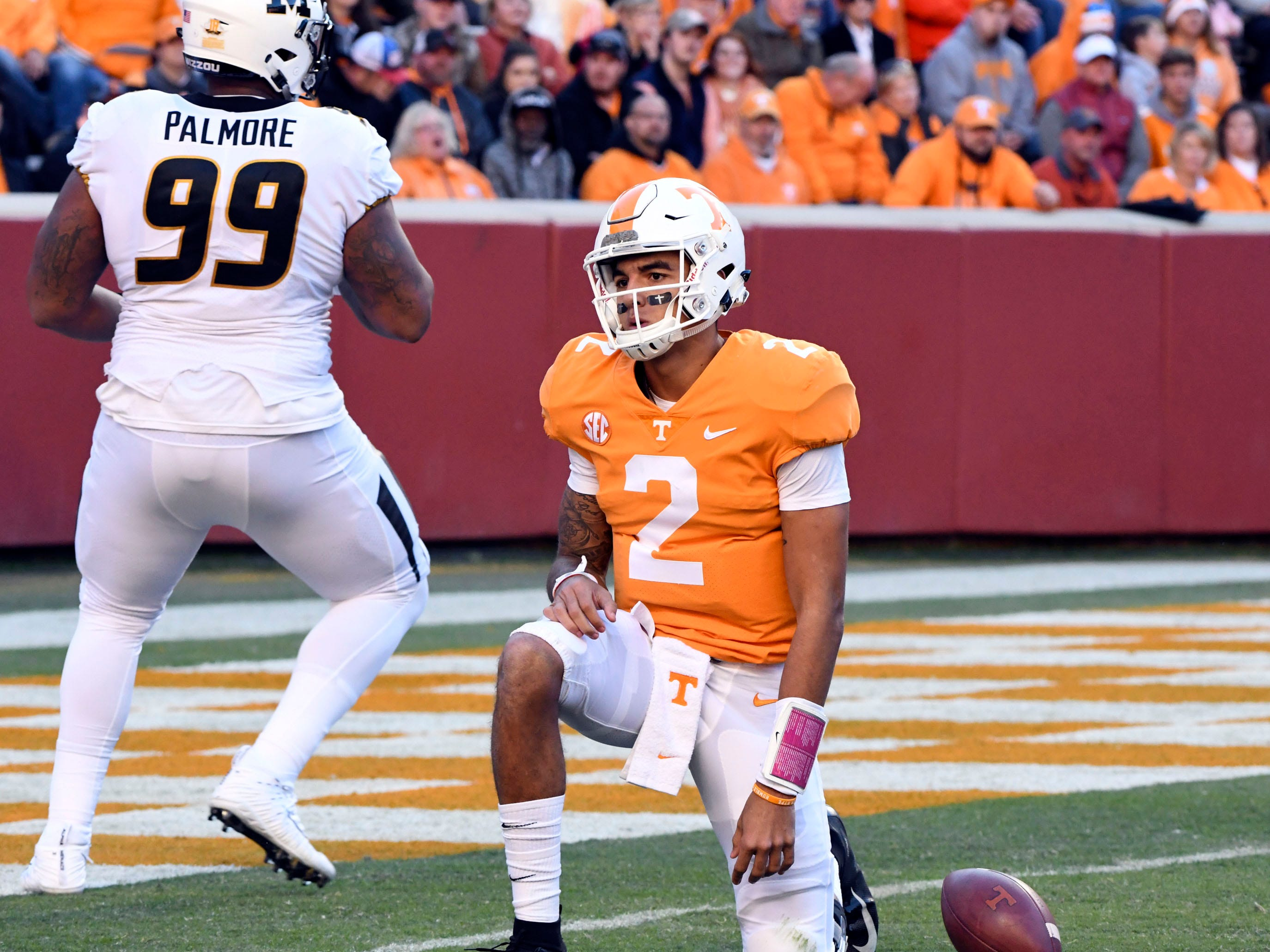 Tennessee quarterback Jarrett Guarantano (2) gets back up after getting sacked by Missouri defensive lineman Walter Palmore (99) during the Tennessee and Missouri football game on Saturday, November 17, 2018.