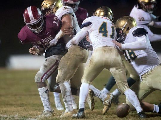 Oak Ridge's Herbert Booker (13) fumbles the ball. Knoxville Catholic defeats Oak Ridge, 42-40 in the 5A quarterfinals on Friday, November 16, 2018.