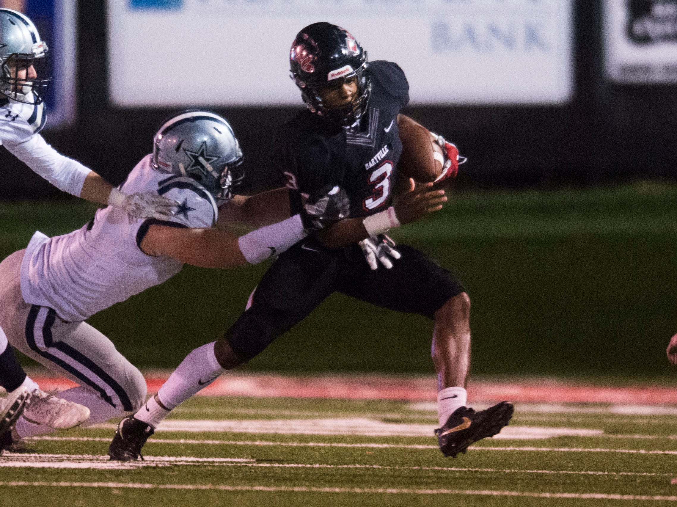 Maryville's A.J. Davis (3) runs with the ballduring a 6A quarterfinal game between Maryville and Farragut at Maryville Friday, Nov. 16, 2018. Maryville defeated Farragut 26-10.