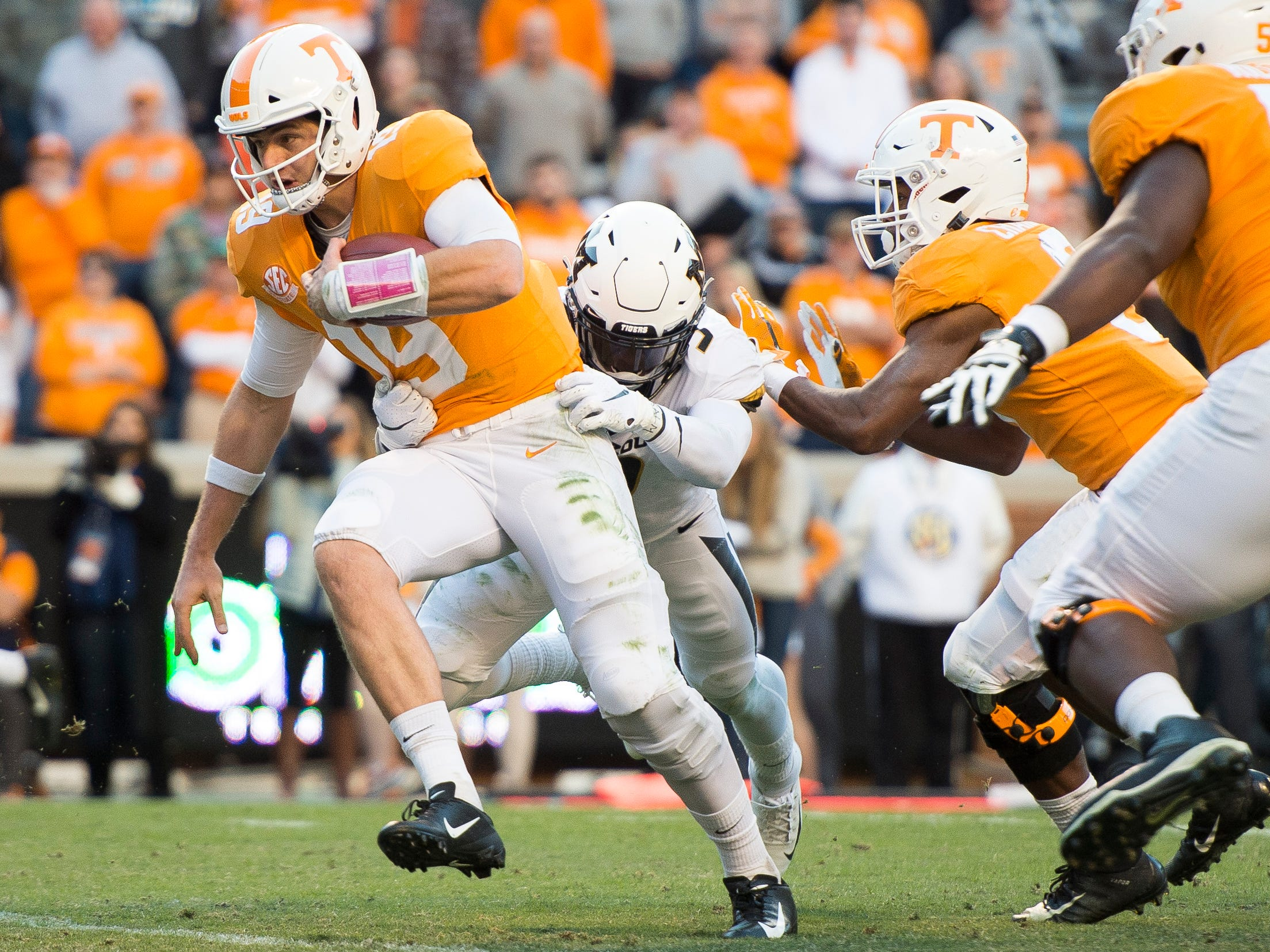 Tennessee quarterback Keller Chryst (19) fights for extra yardage during the Tennessee Volunteers game against the Missouri Tigers in Neyland Stadium on Saturday, November 17, 2018.