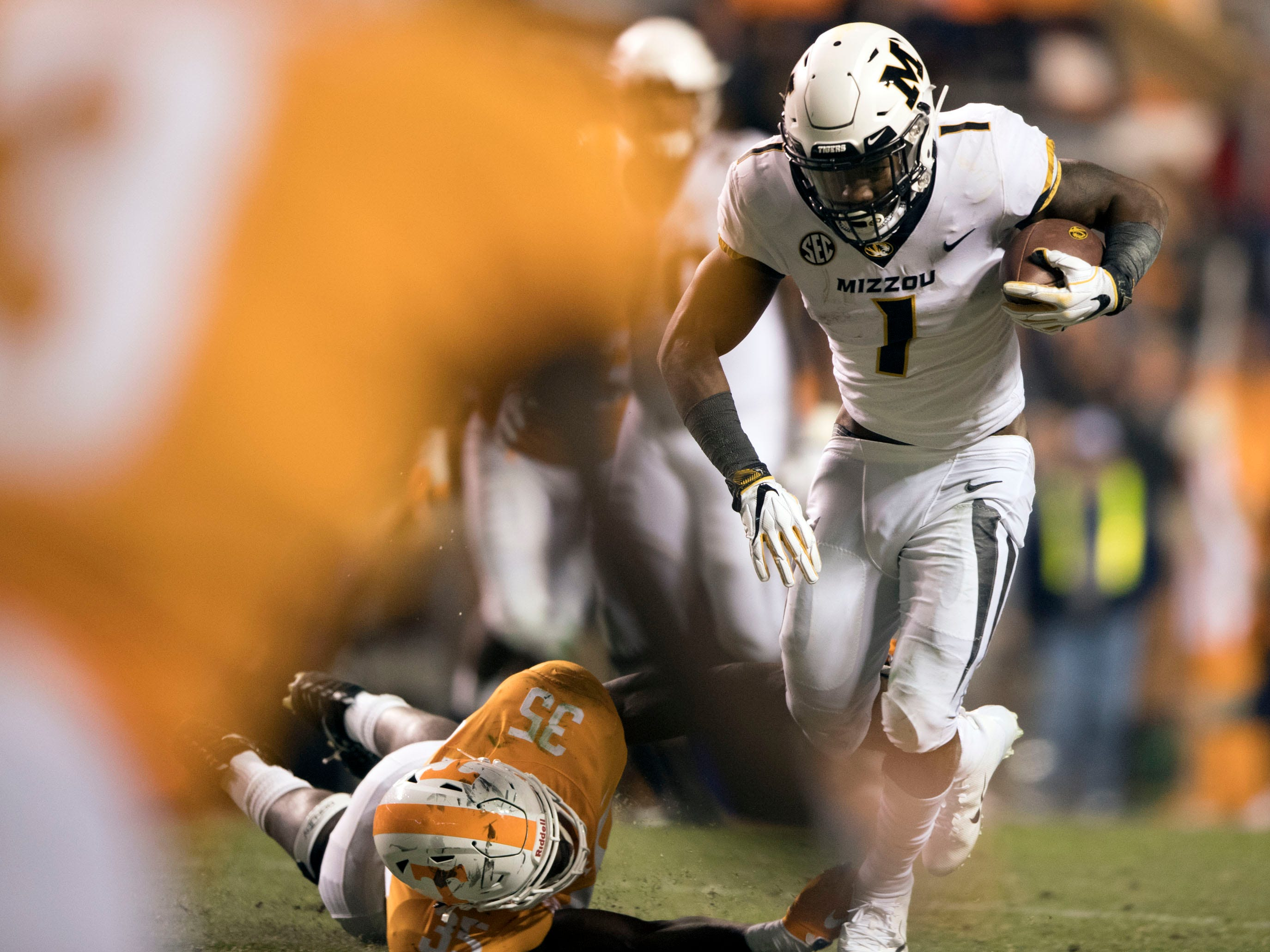 Missouri running back Tyler Badie (1) gets through the Tennessee defense during the game on Saturday, November 17, 2018.