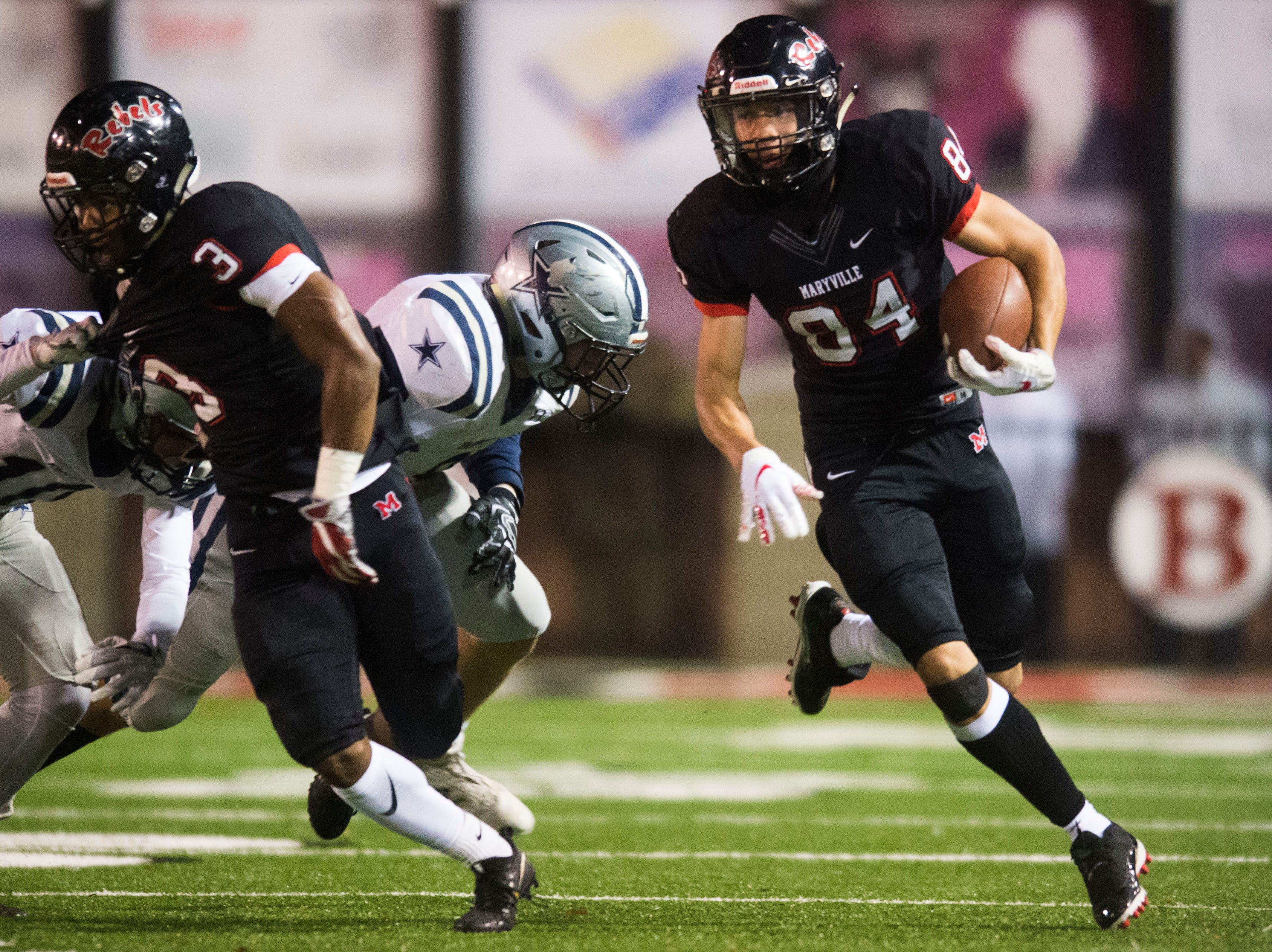 Maryville's Brayden Anderson (84) runs the ball during a 6A quarterfinal game between Maryville and Farragut at Maryville Friday, Nov. 16, 2018. Maryville defeated Farragut 26-10.
