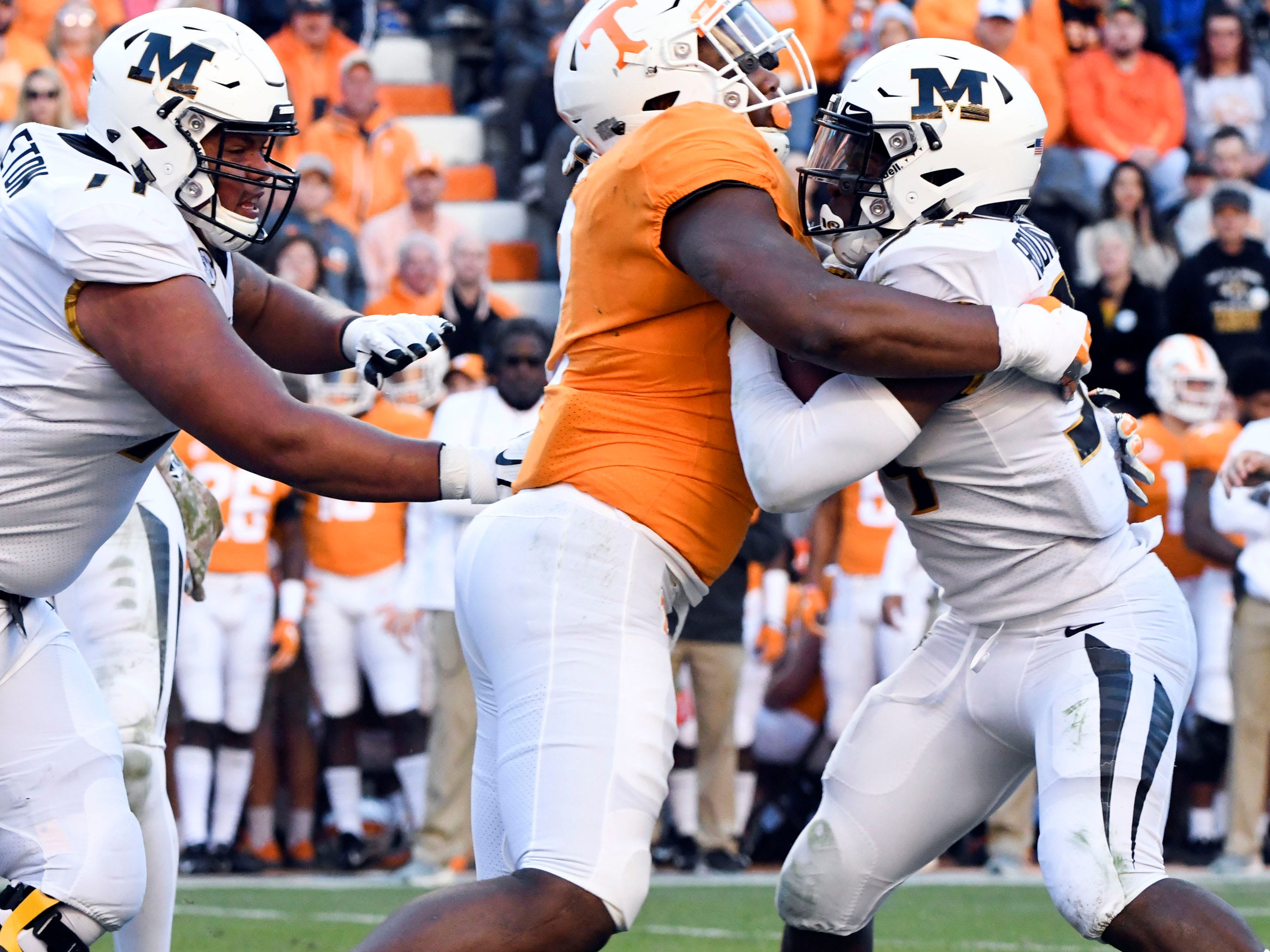 Tennessee defensive lineman Shy Tuttle (2) stop Missouri running back Larry Rountree III (34) during the Tennessee and Missouri football game on Saturday, November 17, 2018.
