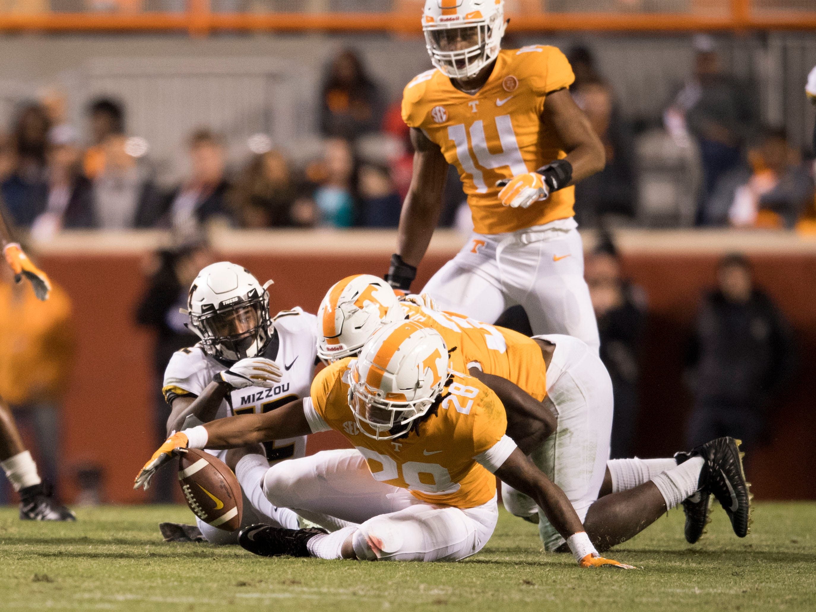Tennessee defensive back Baylen Buchanan (28) recovers a fumble during the Tennessee and Missouri football game on Saturday, November 17, 2018.