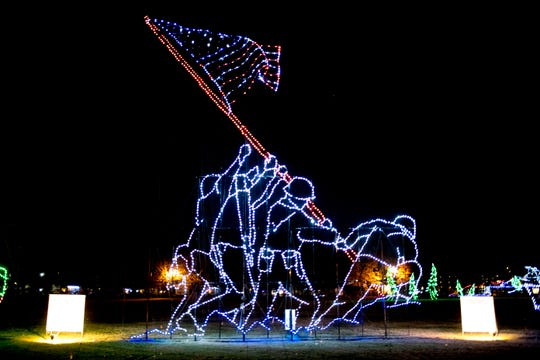"The famous ""Raising of the Flag on Iwo Jima"" is recreated in a light display at the annual Winterfest holiday lights display at Patriot Park in Pigeon Forge, Tennessee on Friday, November 16, 2018."