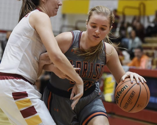 Harrison's Sydney Jacobsen drives the baseline against McCutcheon Friday night.