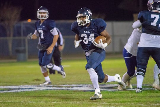 LCA running back Logan Gabriel had 182 yards and three touchdowns rushing in addition to a a 70-yard touchdown reception during Friday's 56-14 win over Opelousas Catholic.