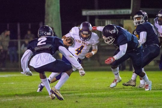 Opelousas Catholic's quarterback Jesse Roy charges through the defense as the Lafayette Christian Academy Knights take on the Opelousas Catholic Vikings on November 16, 2018.
