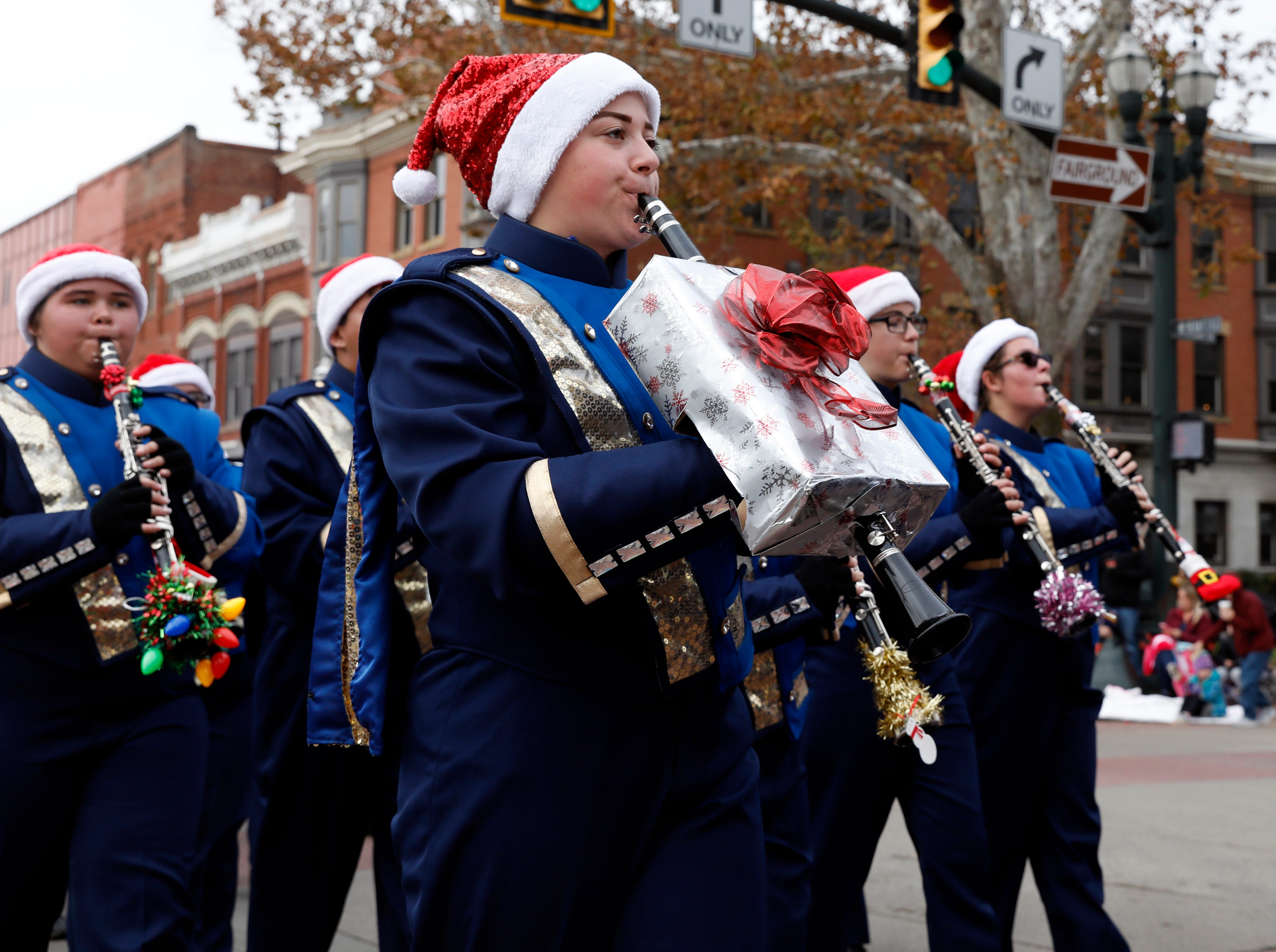 Members of the Lancaster High School Band of Gold march in the Lancaster Holiday Festival Parade Saturday morning, Nov. 17, 2018, in downtown Lancaster.
