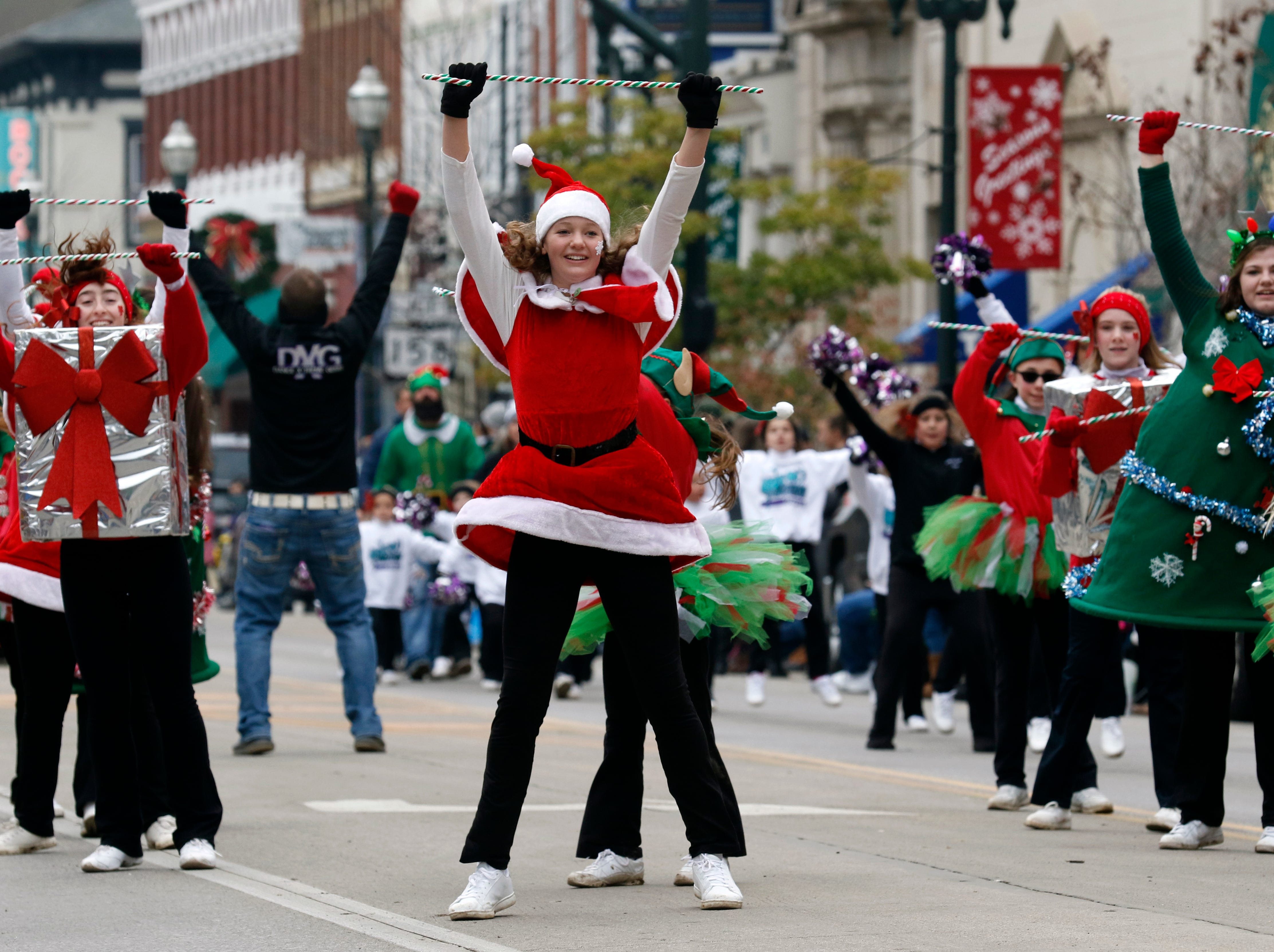 Members of the Kids in Motion dance school perform as they walk in the Lancaster Holiday Festival Parade Saturday, Nov. 17, 2018, in Lancaster.