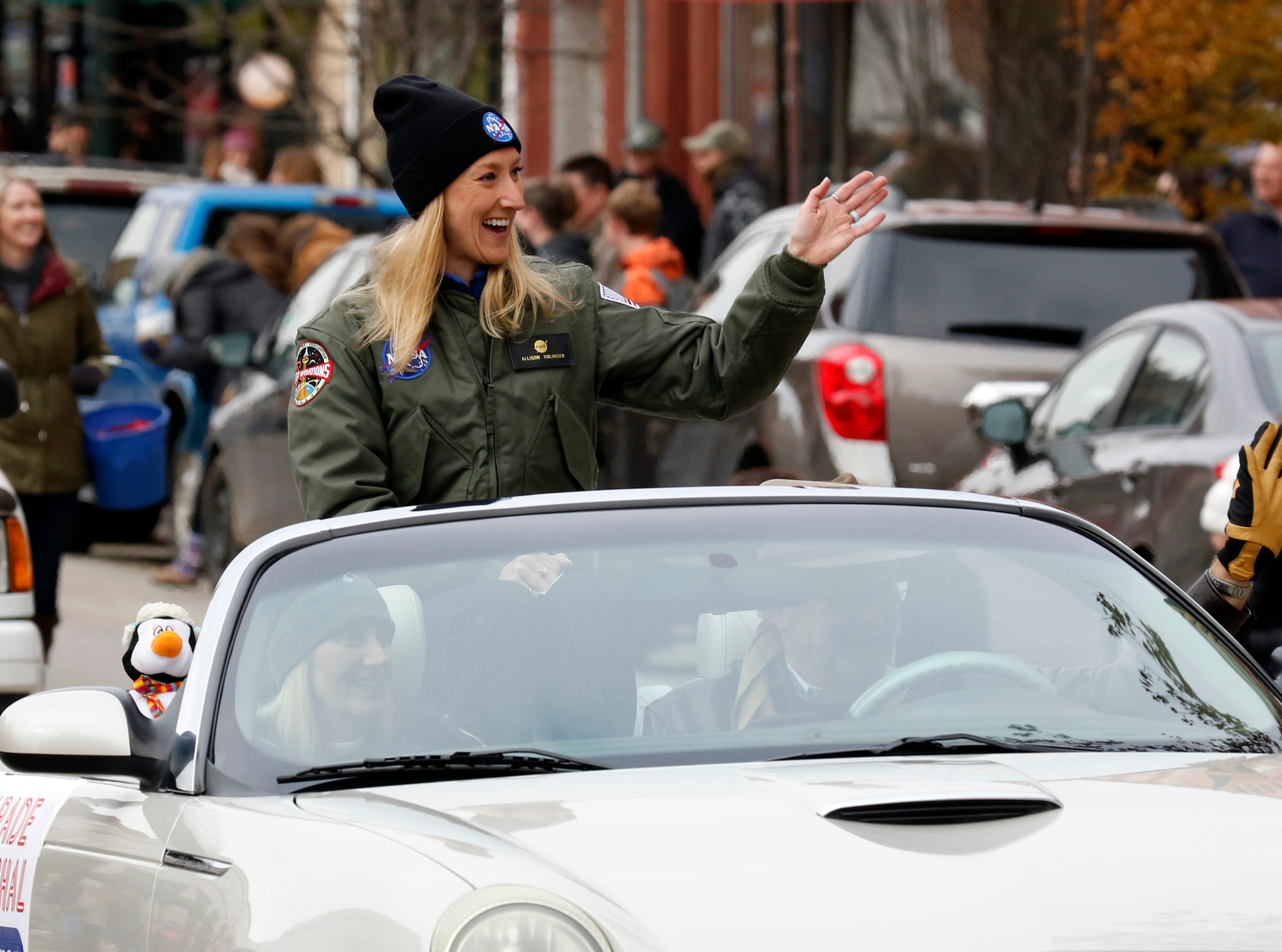 Allison Bolinger, a Lancaster native, waves to people along parade route Saturday, Nov. 17, 2018, during the Lancaster Holiday Festival Parade in downtown Lancaster. Bolinger was named a NASA flight director earlier and served as the grand marshal of the parade.