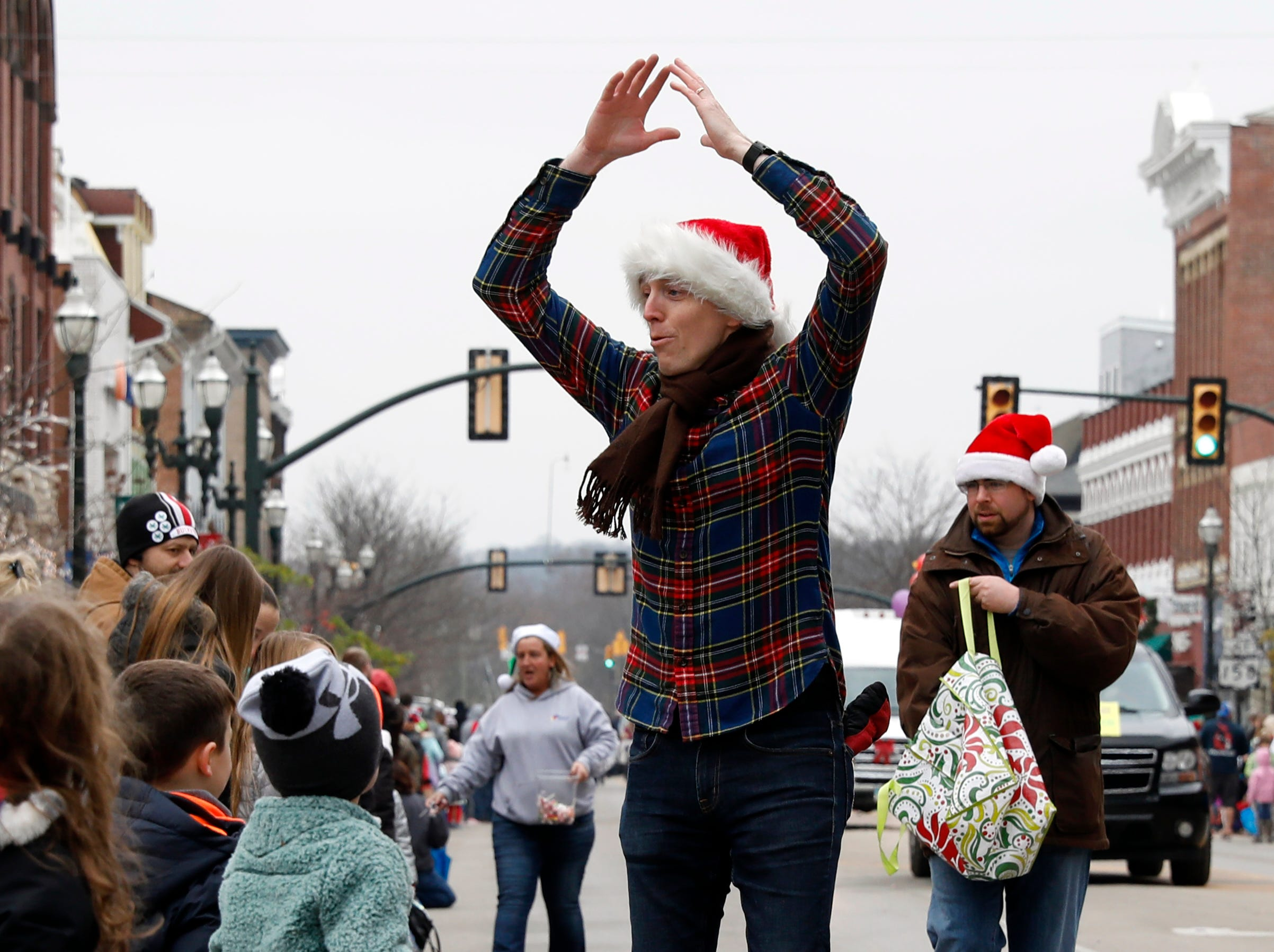 Hundreds of people gathered along the parade route of the Lancaster Holiday Festival Parade Saturday, Nov. 17, 2018, in downtown Lancaster.