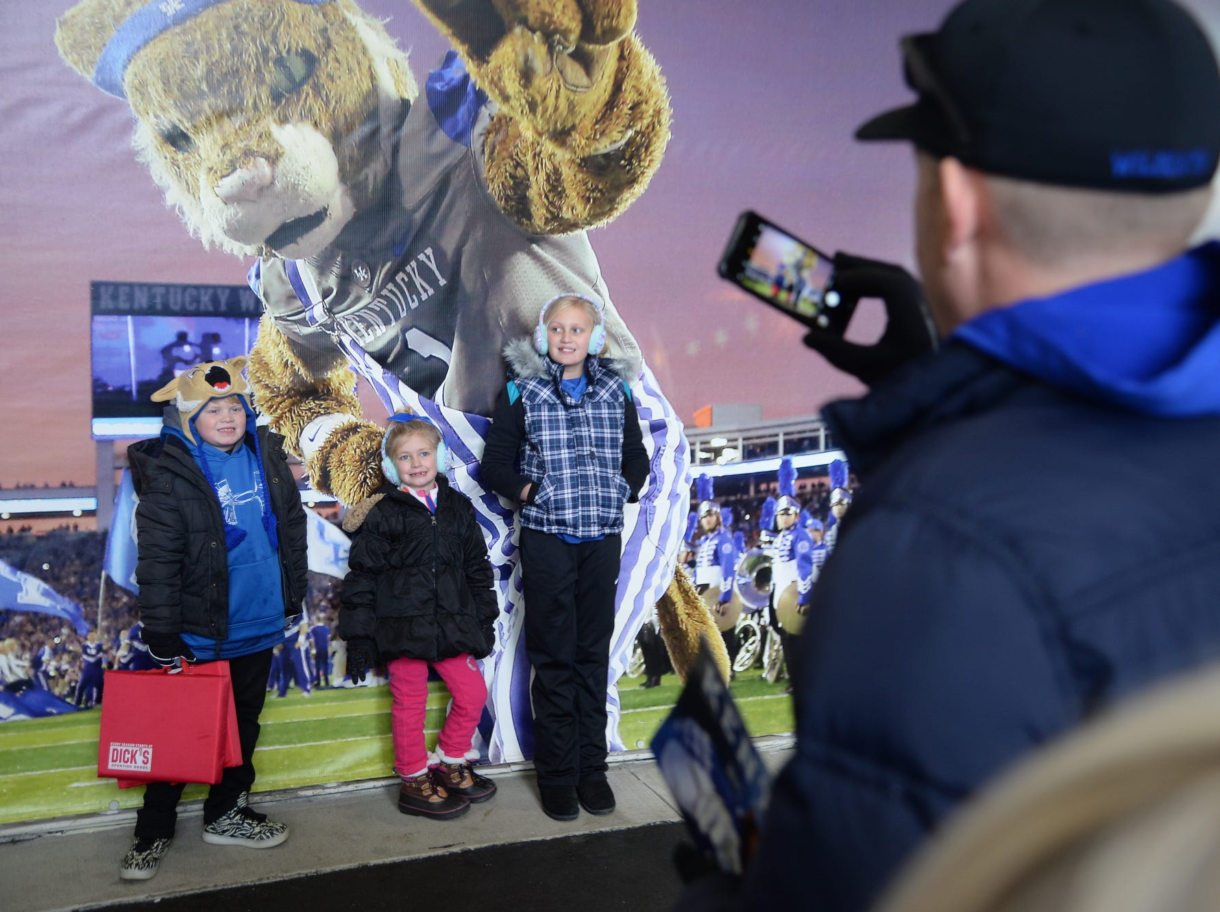 UK fans get their photo made in front of the Wildcat before the University of Kentucky football game against Middle Tennessee at Kroger Field in Lexington, Kentucky on Saturday, November 17, 2018.