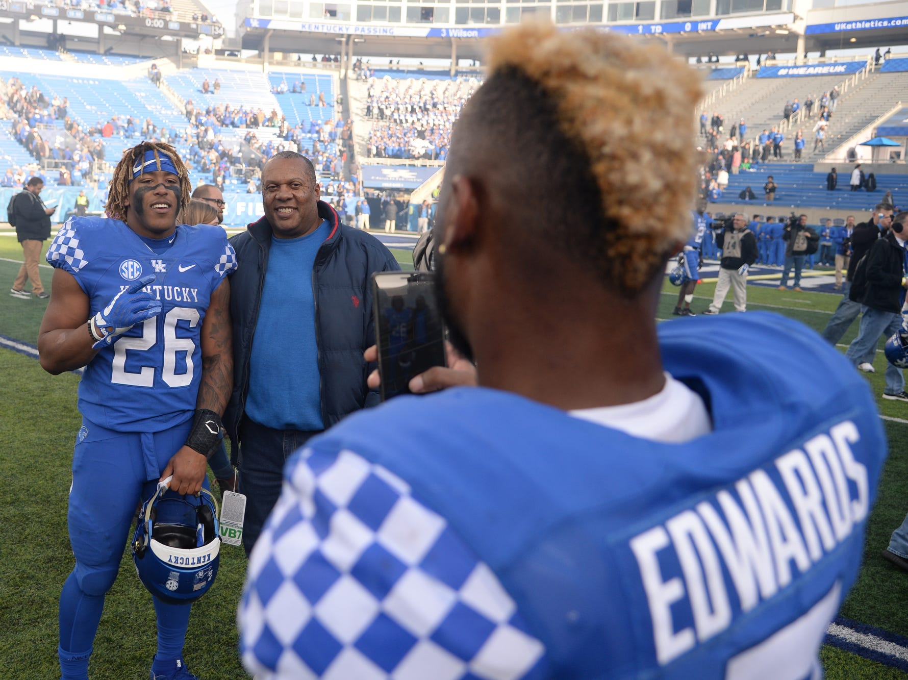 UK RB Benny Snell Jr., has his photo taken by SS Mike Edwards after the University of Kentucky football game against Middle Tennessee at Kroger Field in Lexington, Kentucky on Saturday, November 17, 2018.