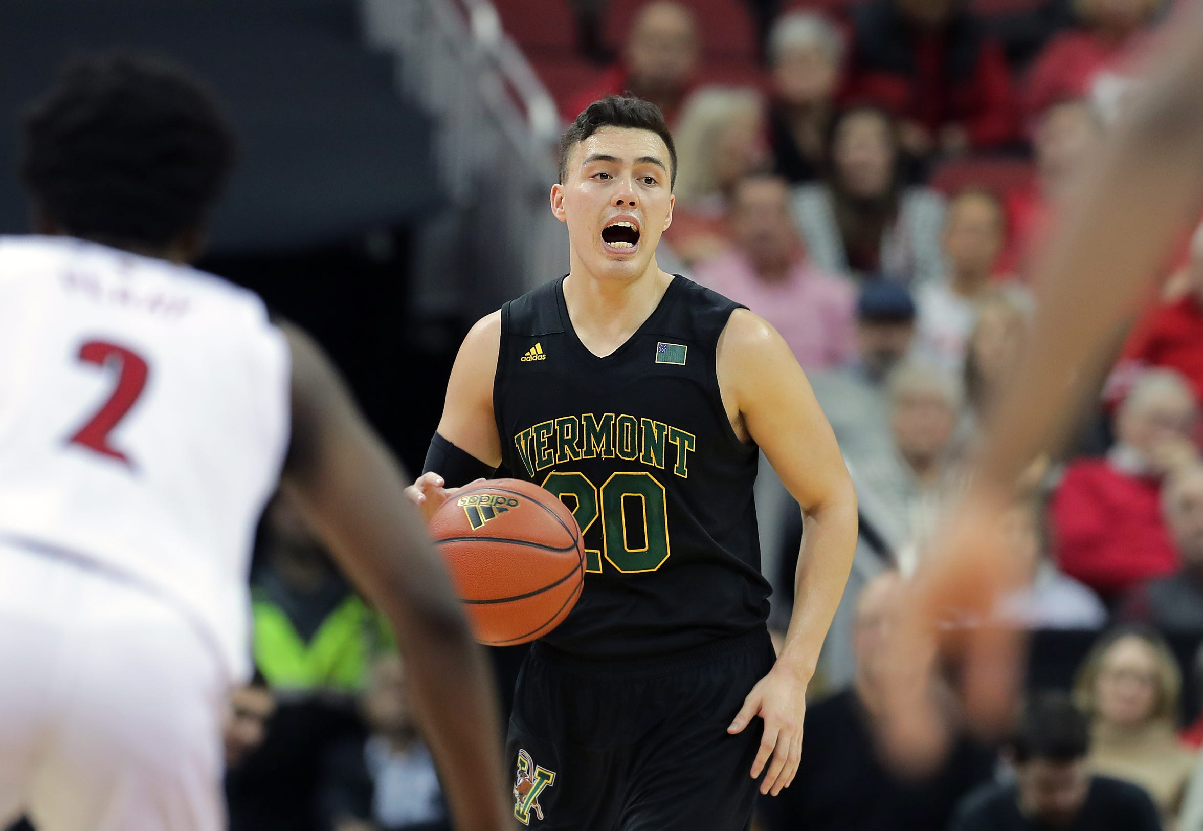 Vermont's Ernie Duncan brings the ball up court.