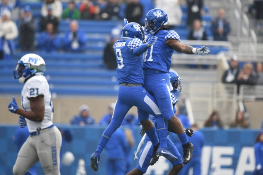 UK FS Davonte Robinson and DE Josh Allen celebrate a fumble recovery during the University of Kentucky football game against Middle Tennessee at Kroger Field in Lexington, Kentucky on Saturday, November 17, 2018.