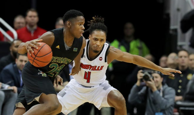 Louisville's Khwan Fore guards Vermont's Ben Shungu during the game at the KFC Yum Center in Louisville, Ky. Nov. 16, 2018