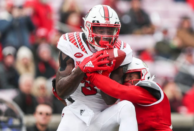 NC State's Kelvin Harmon managed to hold onto this pass for a touchdown over Louisville's Anthony Johnson in the first half Saturday afternoon at Cardinal Stadium. Nov. 17, 2018