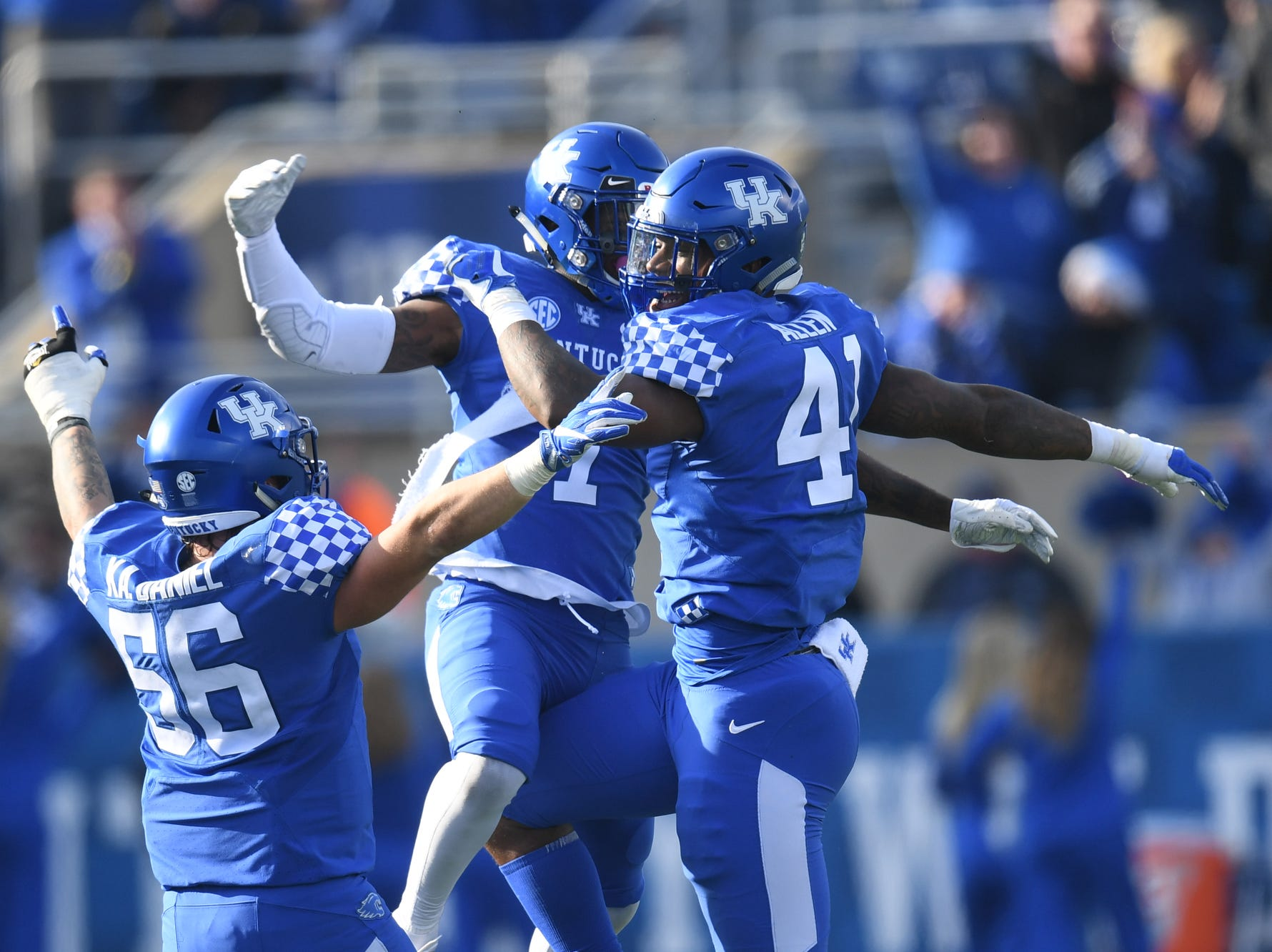 UK players Kash Daniel, Mike Edwards, and Josh Allen celebrate during the University of Kentucky football game against Middle Tennessee at Kroger Field in Lexington, Kentucky on Saturday, November 17, 2018.