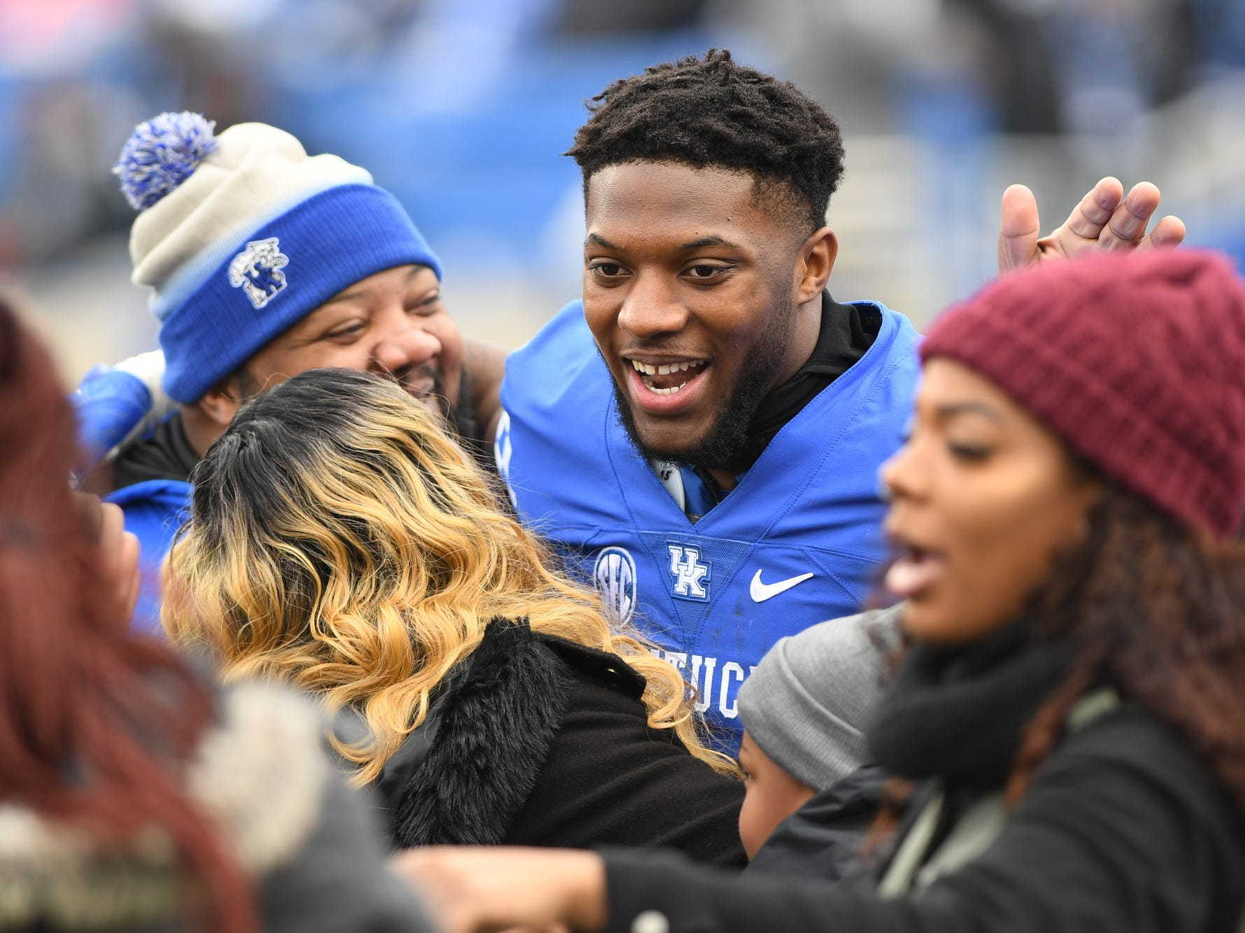 UK DE Josh Allen with his family on senior day before the University of Kentucky football game against Middle Tennessee at Kroger Field in Lexington, Kentucky on Saturday, November 17, 2018.