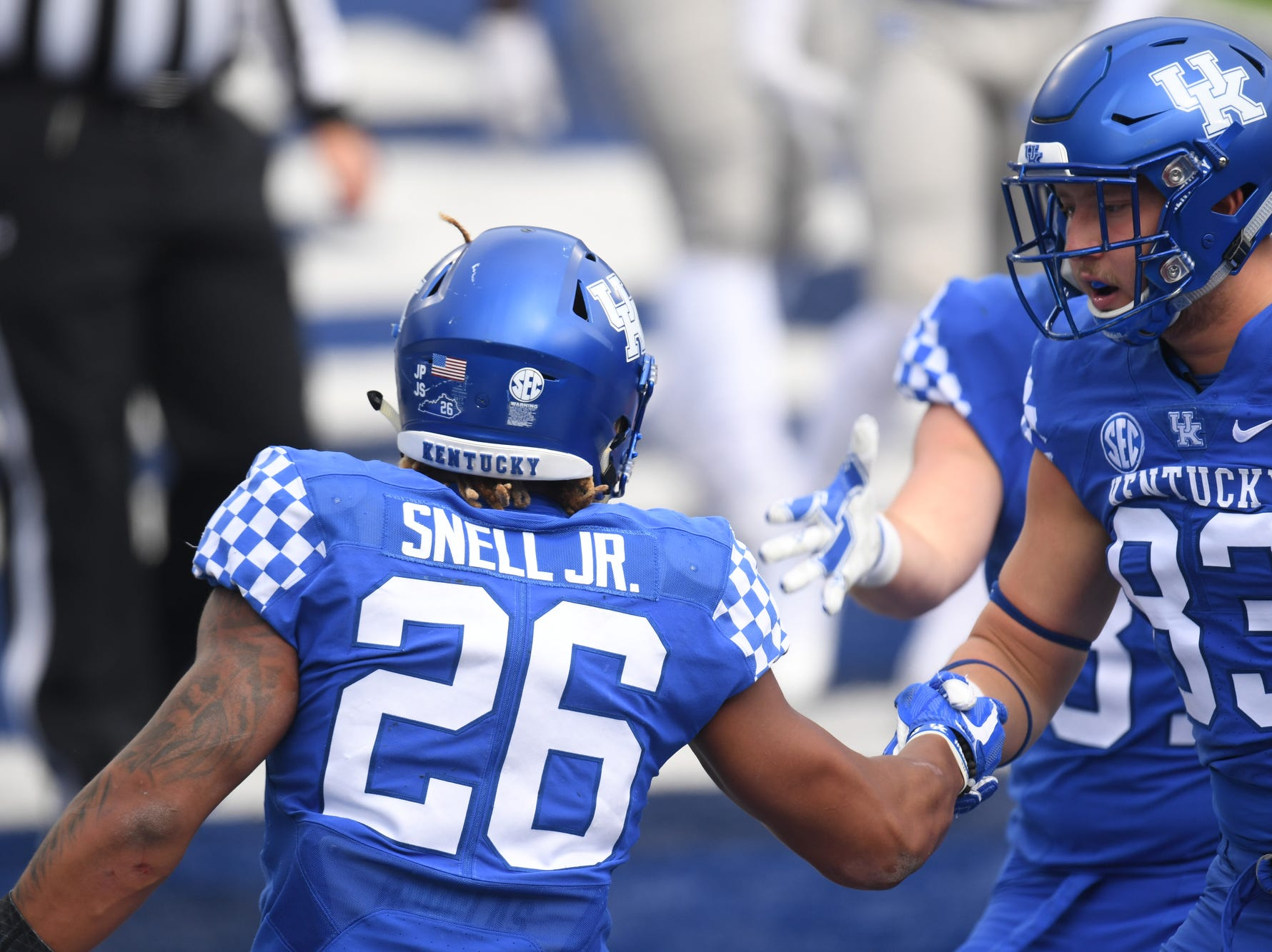 UK RB Benny Snell Jr. celebrates a touchdown with teammates during the University of Kentucky football game against Middle Tennessee at Kroger Field in Lexington, Kentucky on Saturday, November 17, 2018.