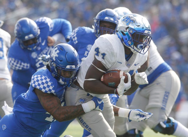 Nov 17, 2018; Lexington, KY, USA; Kentucky senior Josh Allen tackles Middle Tennessee Blue Raiders running back Chaton Mobley (44) in the first half at Kroger Field.
