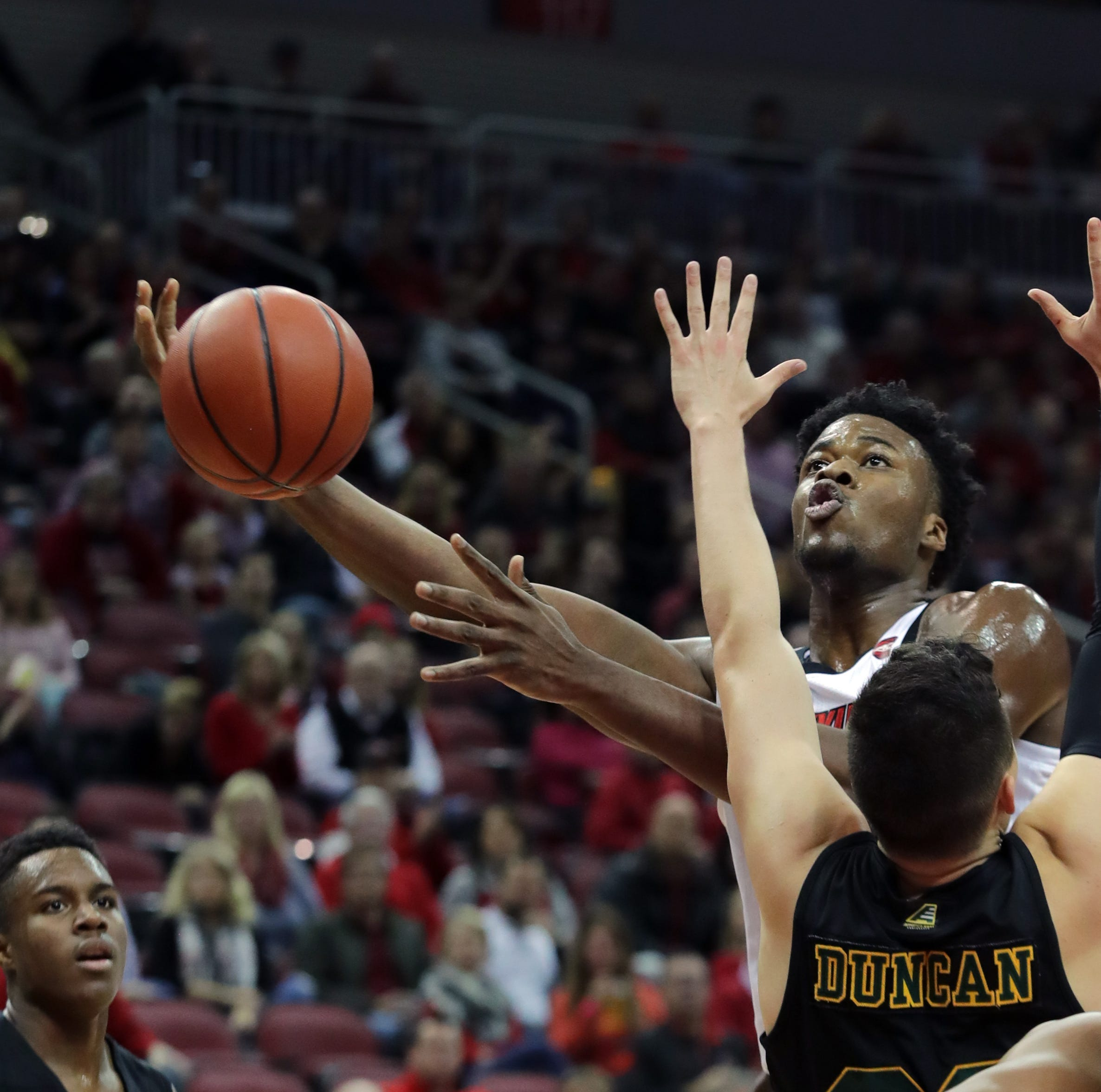 Louisville's Steven Enoch makes a move around Vermont's Ernie Duncan for two at the KFC Yum Center in Louisville, Ky. Nov. 16, 2018