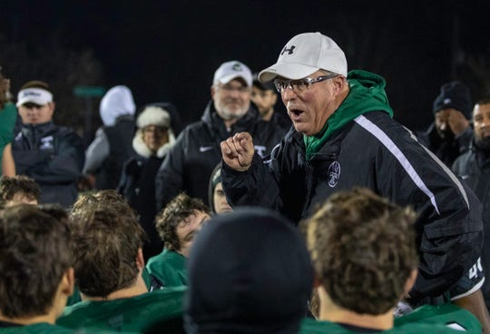 Trinity's Bob Beatty speaks to his team after their 50-0 playoff win over Ballard.