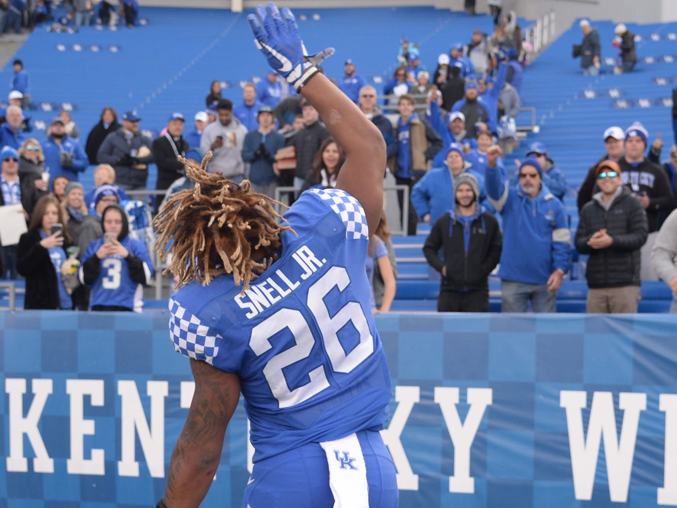 UK RB Benny Snell Jr., throws his glove to fans after the University of Kentucky football game against Middle Tennessee at Kroger Field in Lexington, Kentucky on Saturday, November 17, 2018.
