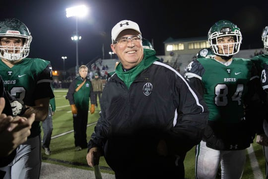 Head Coach Bob Beatty smiles as Trinity accepts their KHSAA 6A regional final trophy after defeating Ballard 50-0 at Marshall Stadium, Friday, Nov. 16, 2018 in Louisville Ky.