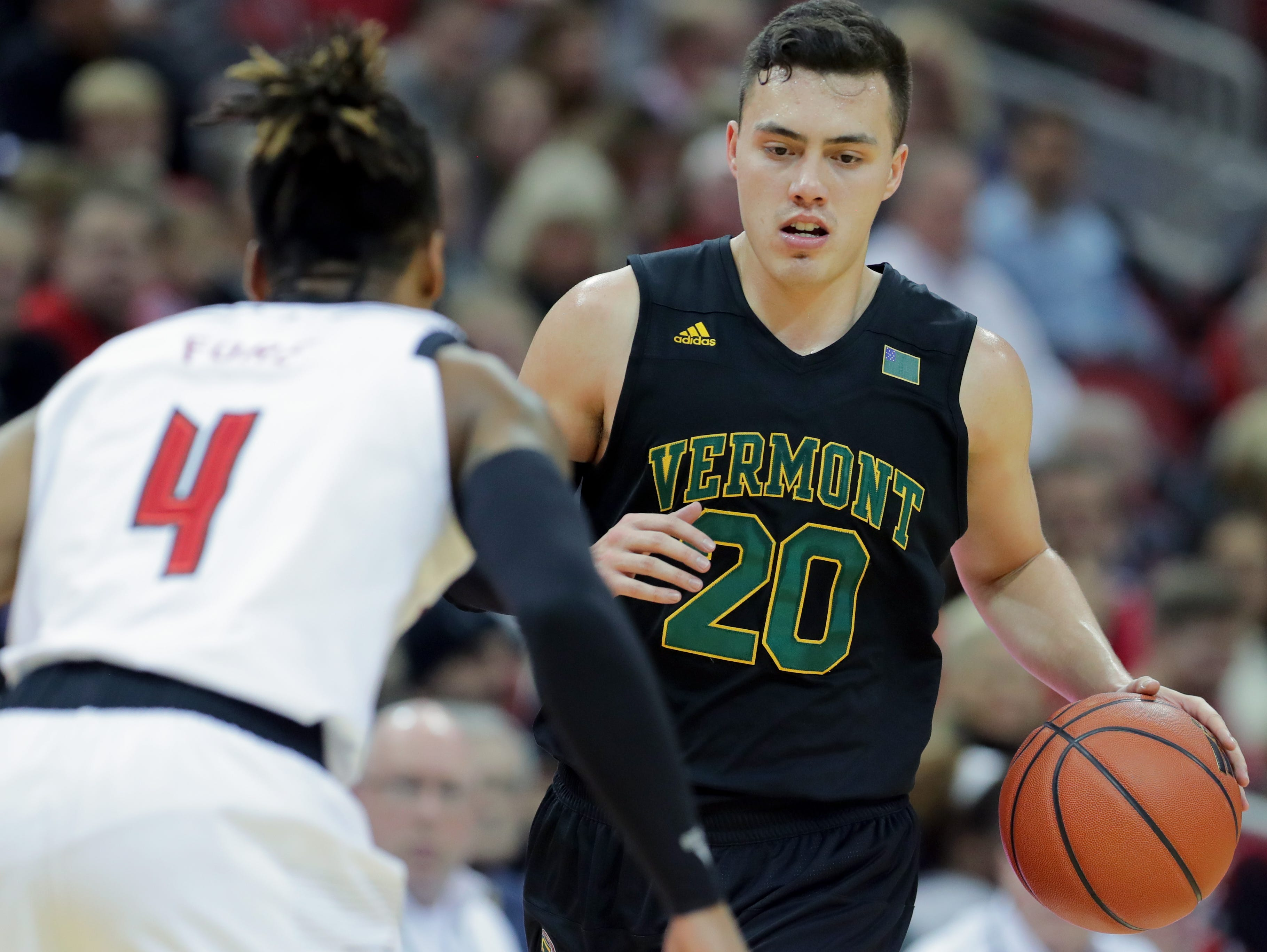 Vermont's Ernie Duncan is guarded Louisville's Khwam Fore.