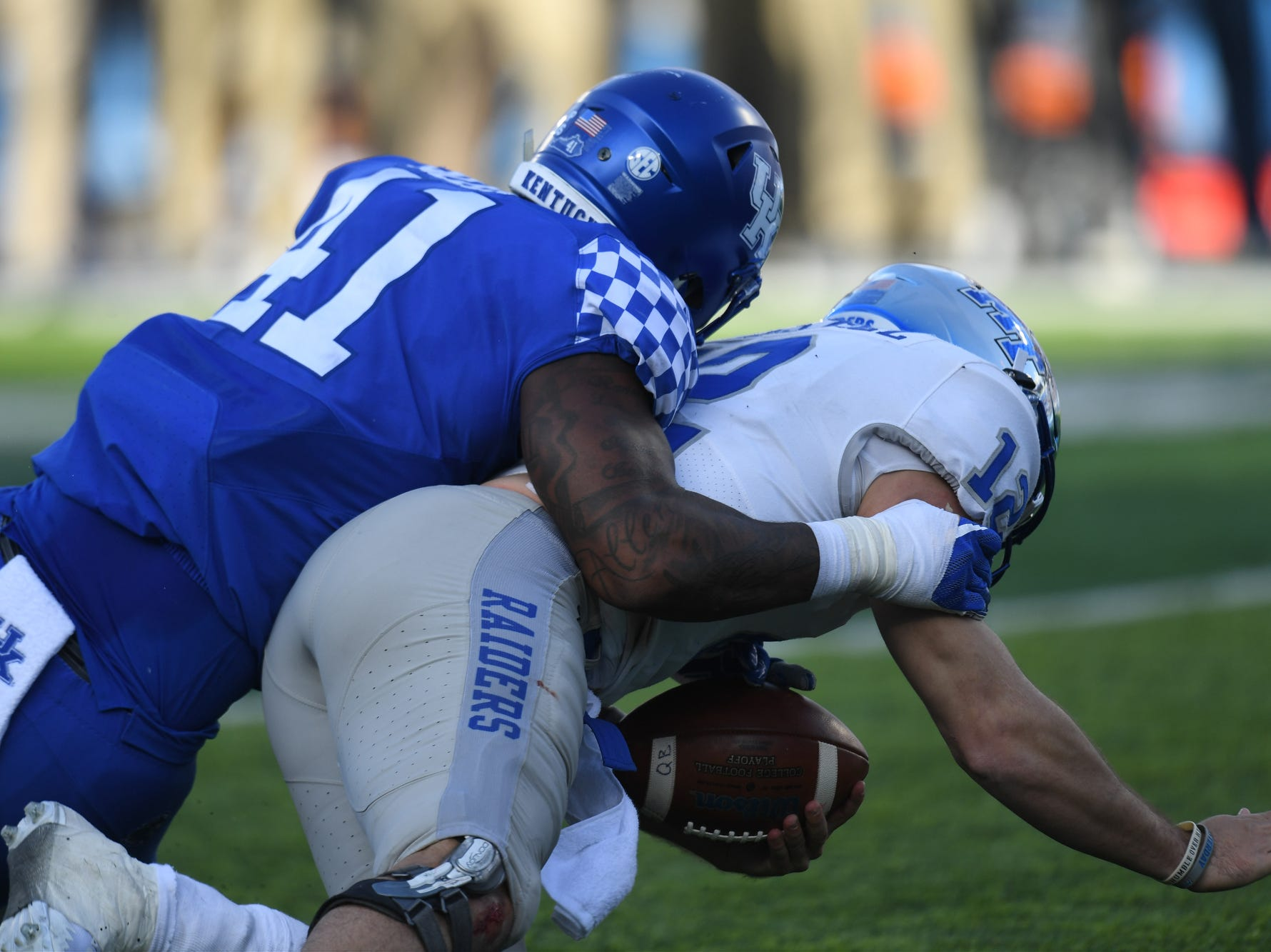 UK DE Josh Allen gets a sack during the University of Kentucky football game against Middle Tennessee at Kroger Field in Lexington, Kentucky on Saturday, November 17, 2018.