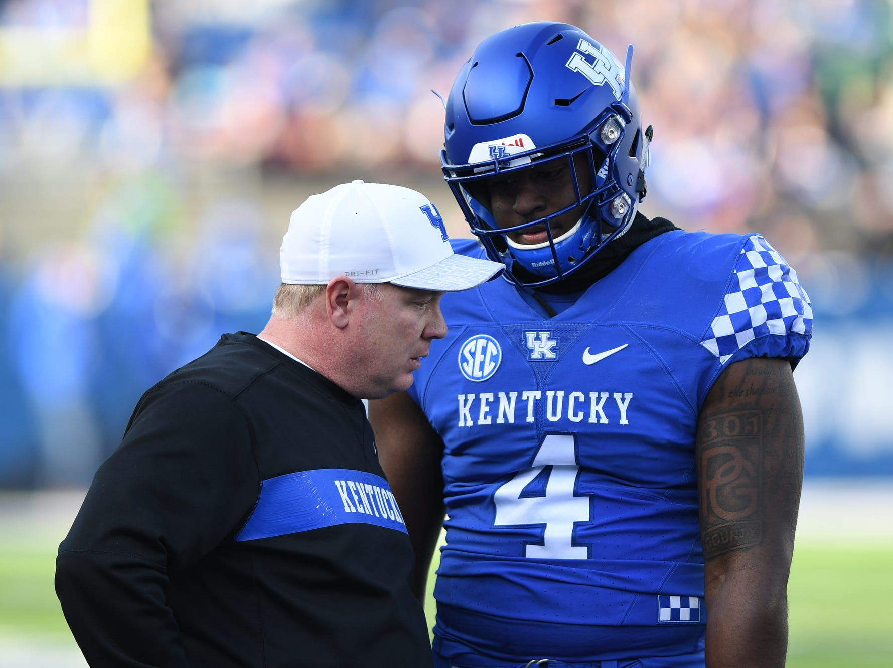 UK head coach Mark Stoops talk to DL Joshua Paschal during the University of Kentucky football game against Middle Tennessee at Kroger Field in Lexington, Kentucky on Saturday, November 17, 2018.
