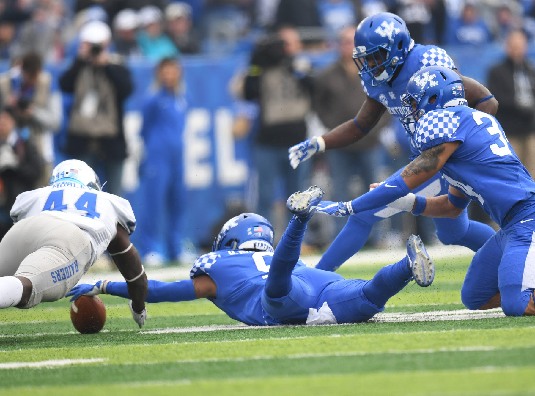 UK FS Davonte Robinson recovers a fumble during the University of Kentucky football game against Middle Tennessee at Kroger Field in Lexington, Kentucky on Saturday, November 17, 2018.