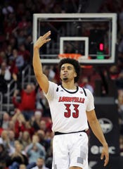 Louisville's Jordan Nwora celebrates making a three against Vermont at the KFC Yum Center in Louisville, Ky. 
