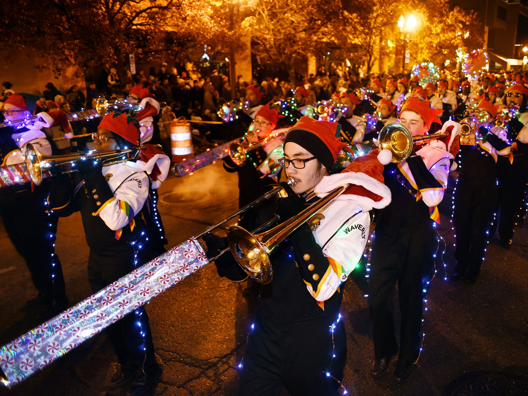 Members of the Waverly High School band play while marching during the Silver Bells in the City Electric Light Parade on Friday, Nov. 16, 2018, in downtown Lansing.