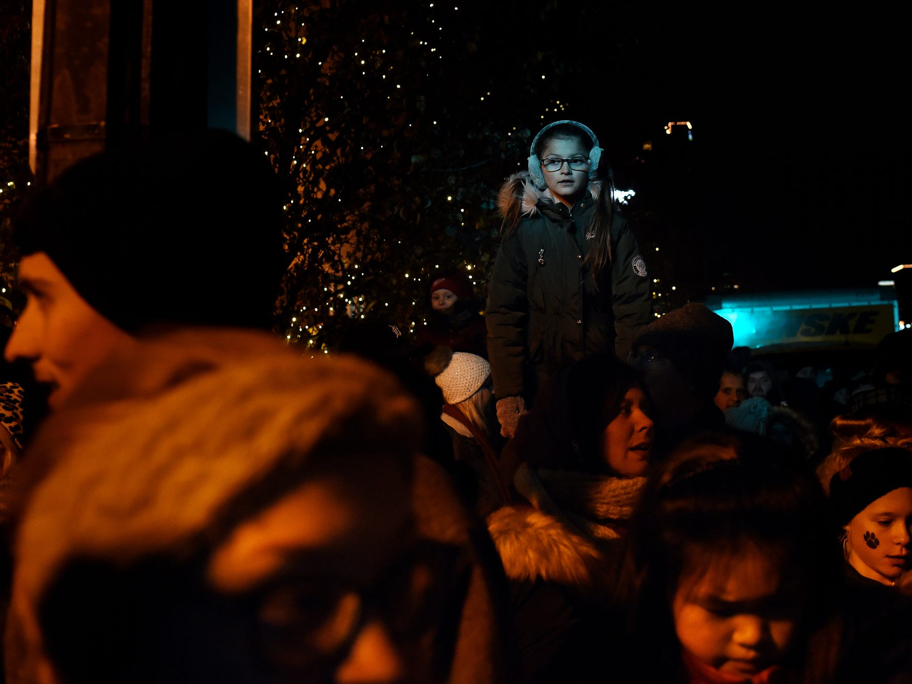 People gather in preparation for the lighting of the state tree outside the Michigan State Capitol during Silver Bells in the City on Friday, Nov. 16, 2018, in downtown Lansing.