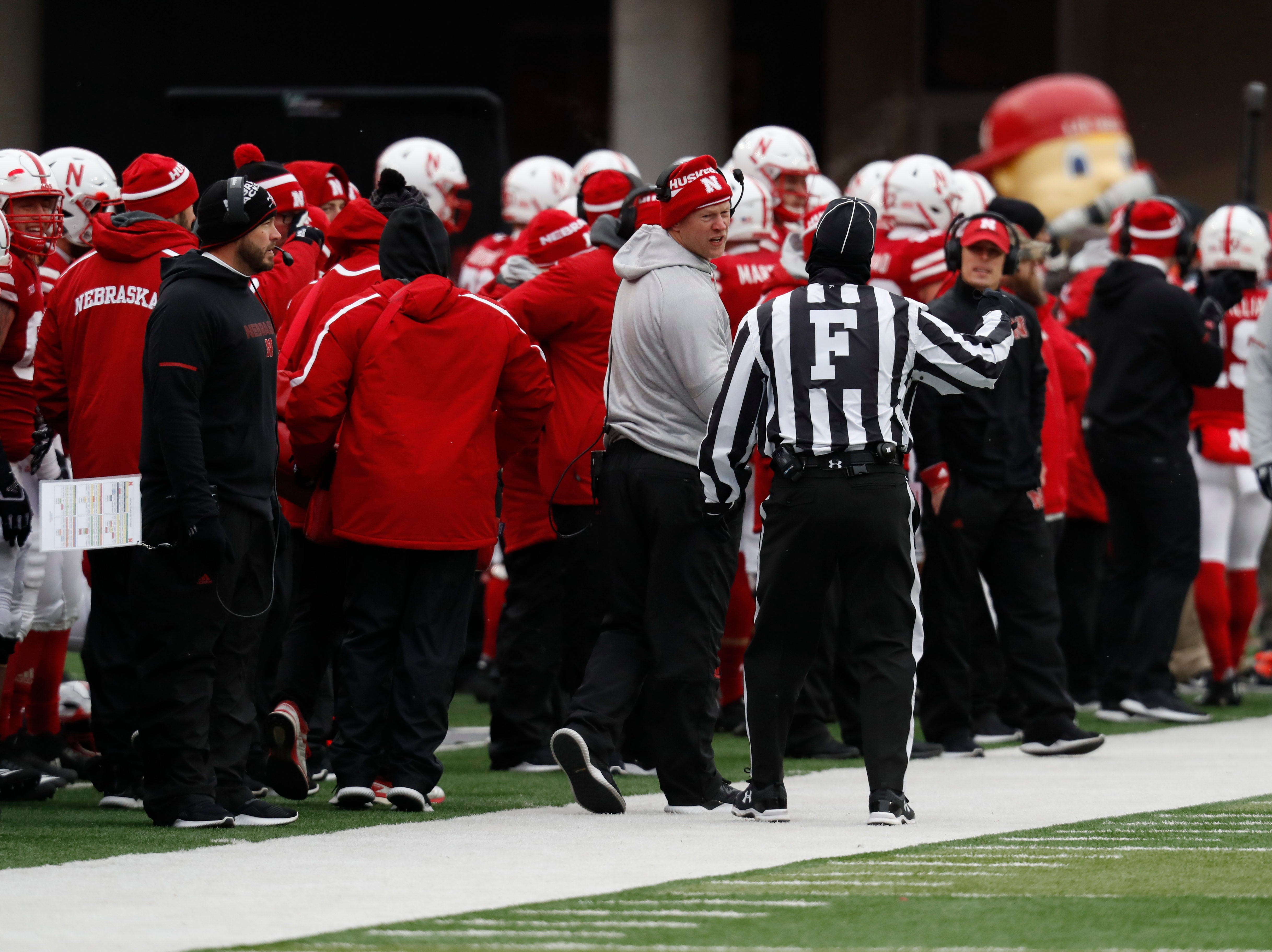 Nov 17, 2018; Lincoln, NE, USA; Nebraska Cornhuskers head coach Scott Frost talks to an official during the game against the Michigan State Spartans in the first half at Memorial Stadium. Mandatory Credit: Bruce Thorson-USA TODAY Sports