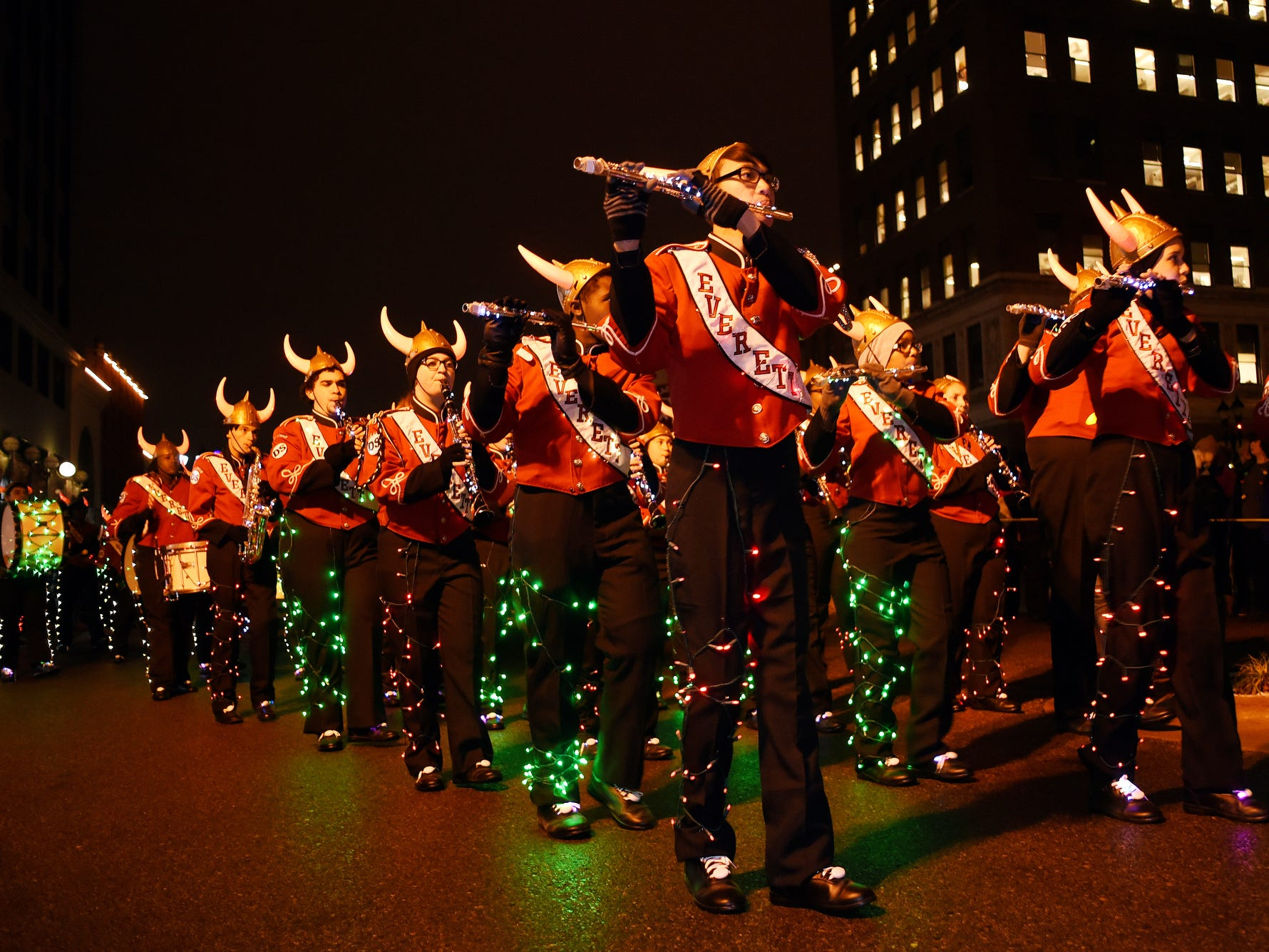The Everett High School marching band performs during the Silver Bells in the City Electric Light Parade on Friday, Nov. 16, 2018, in downtown Lansing.